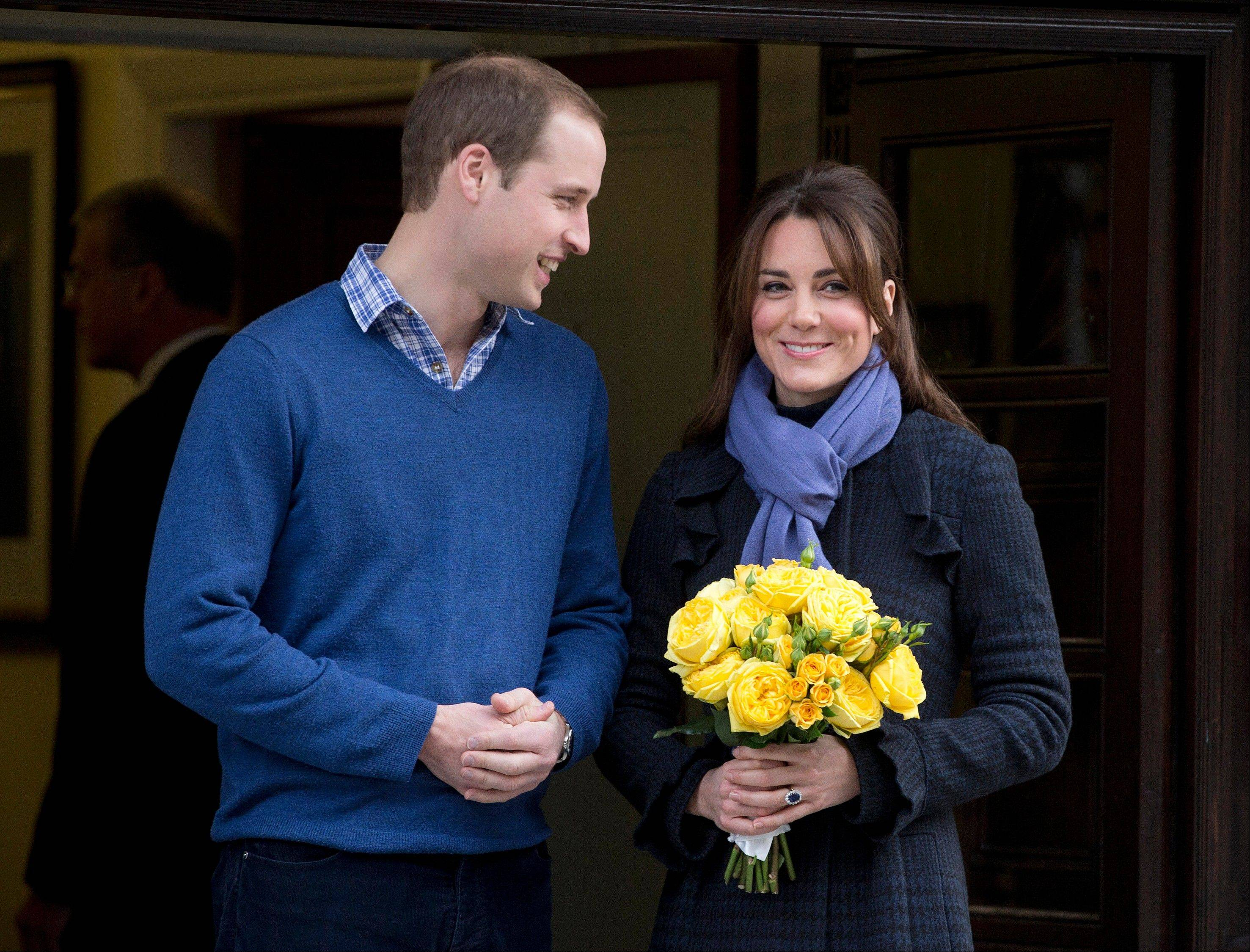 Britain�s Prince William stands next to his wife Kate, Duchess of Cambridge as she leaves the King Edward VII hospital in London Thursday.