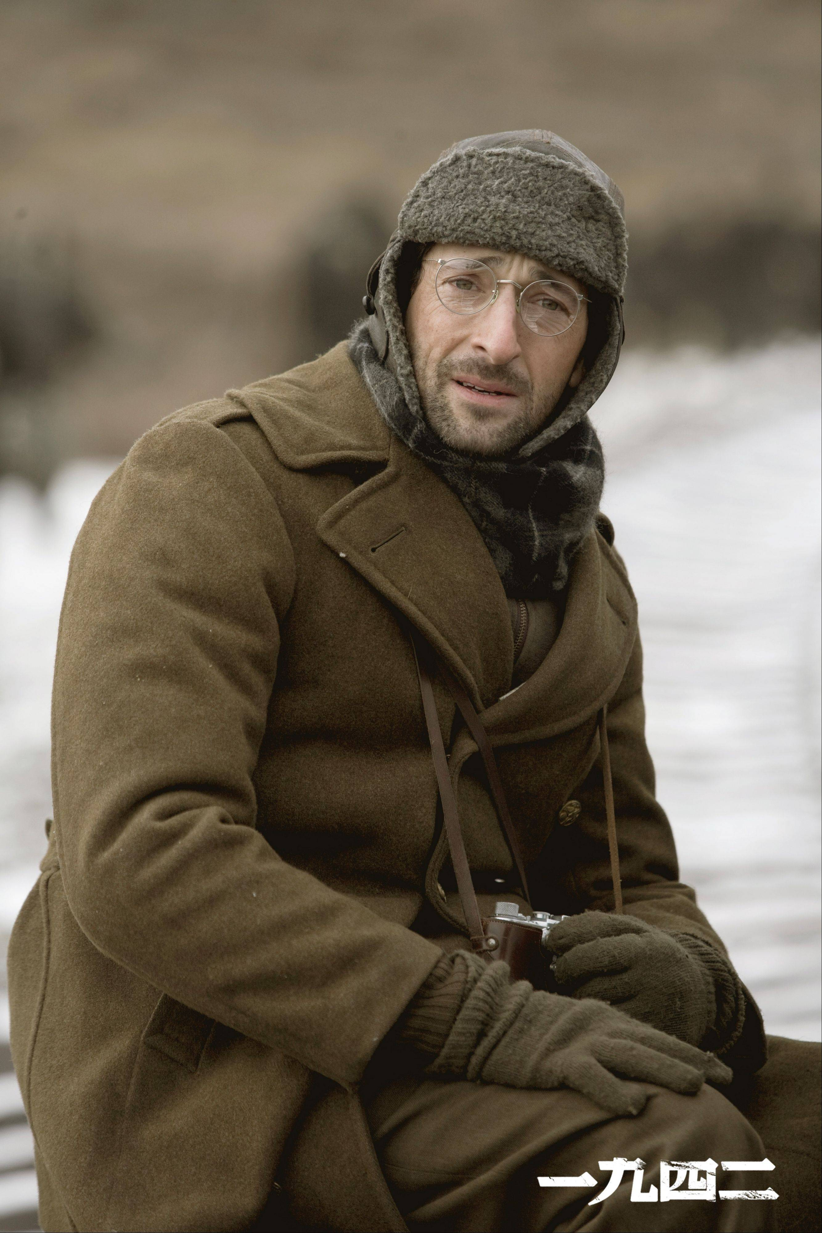 "Oscar-winning actor Adrien Brody plays a Time magazine photographer who chronicles a devastating famine in World War II China in the historical epic ""Back to 1942."""