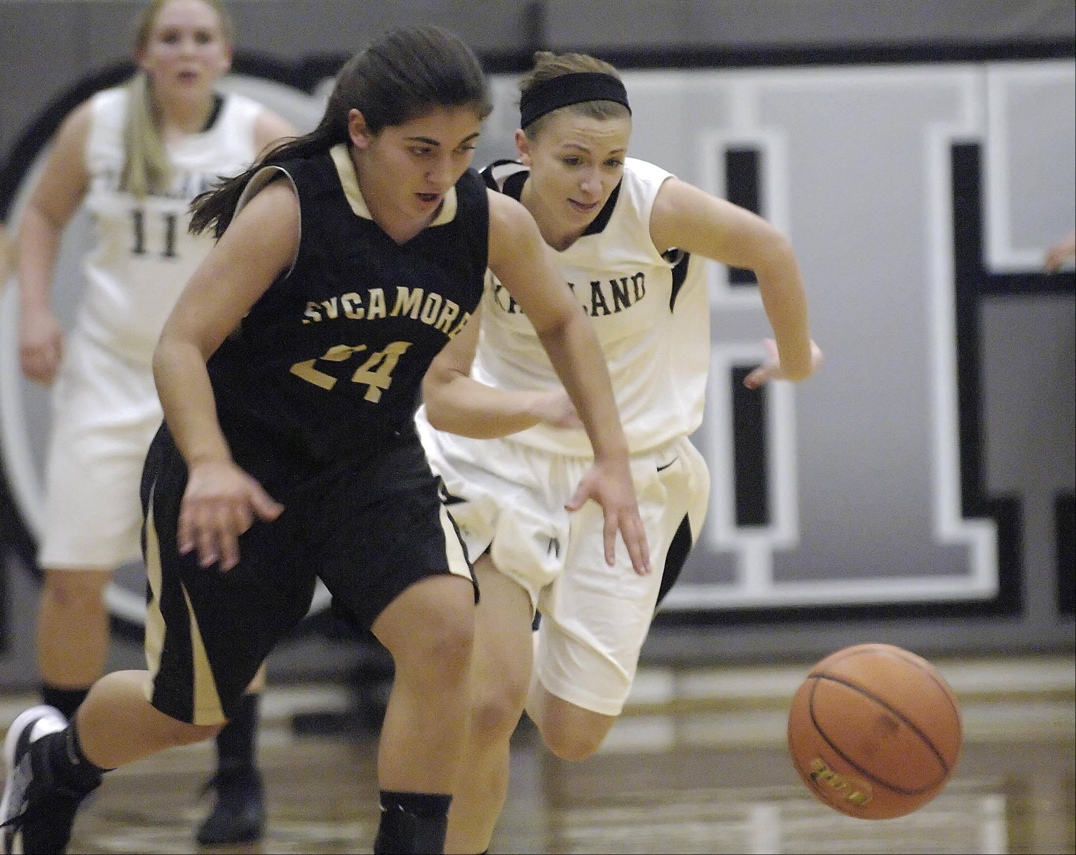 Kaneland�s Caroline Heimerdinger and Sycamore�s Julia Moll chase a loose ball that Heimerdinger poked away Thursday in Maple Park.