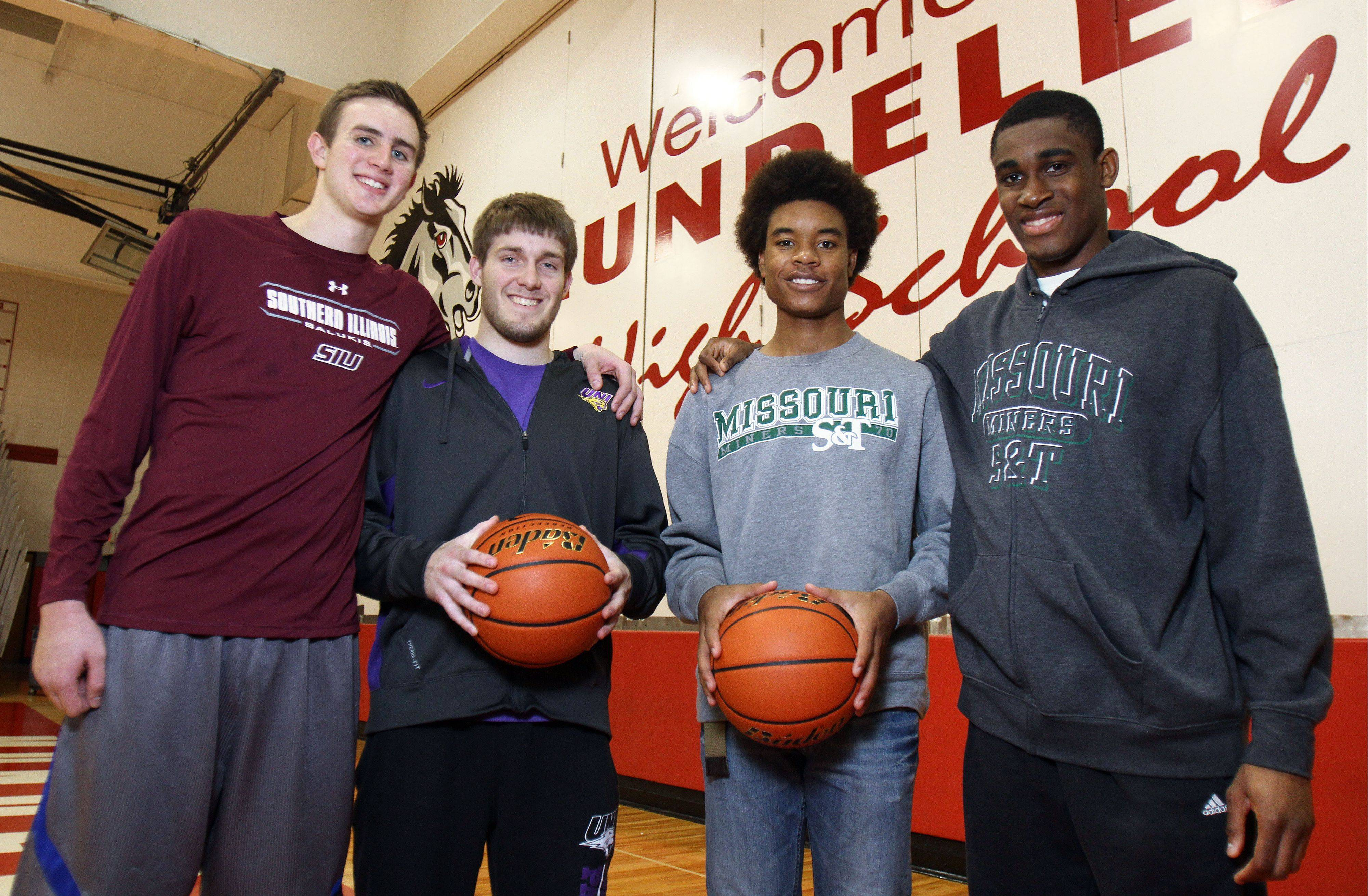 The Mundelein boys basketball team has four players headed for full college scholarships. From left are Sean O�Brien, Robert Knar, Cliff Dunigan and Chino Ebube.