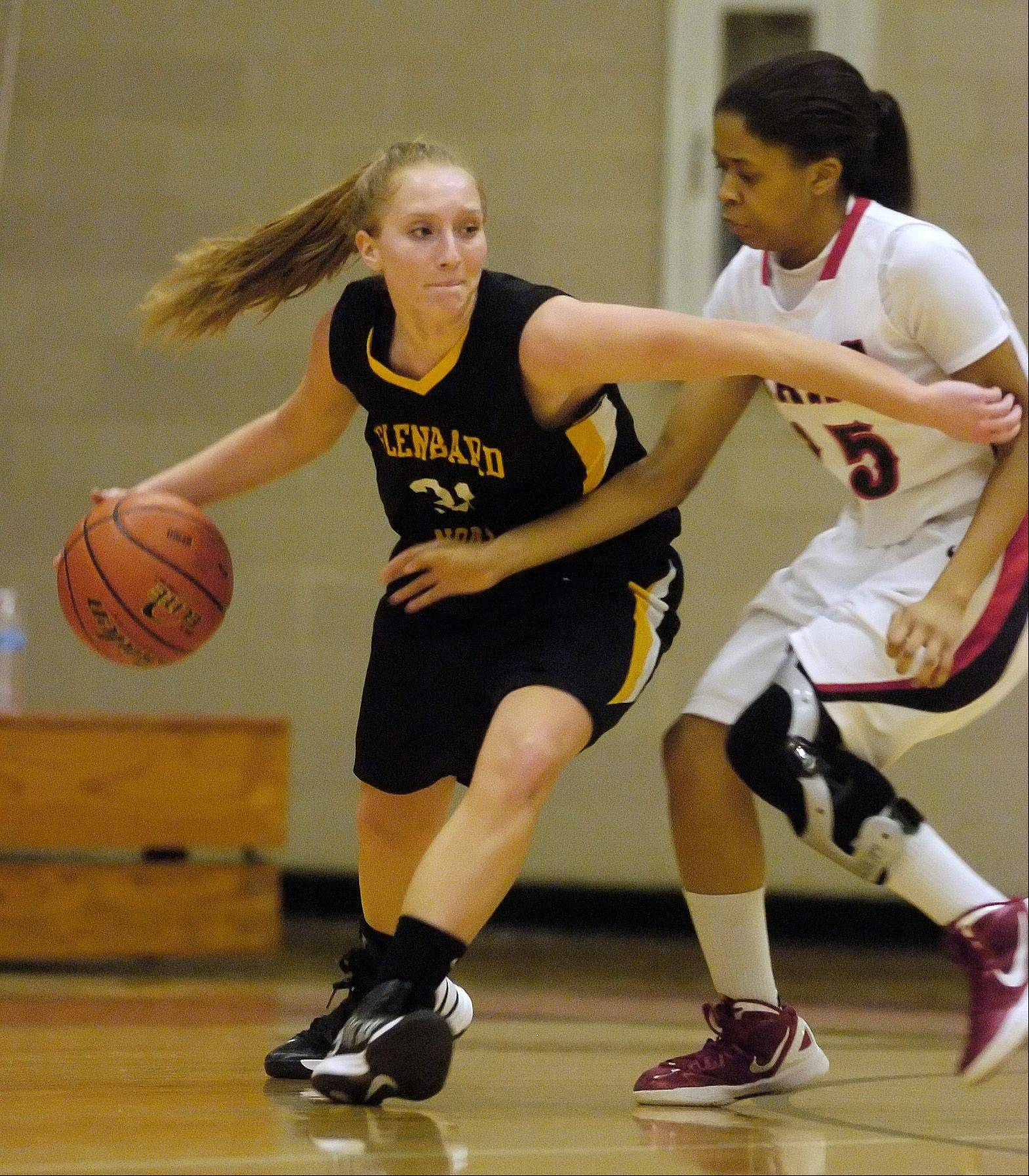 Amy Falson of Glenbard North works to get past Teaira Miller of Glenbard East during varsity girls basketball, Thursday in Lombard