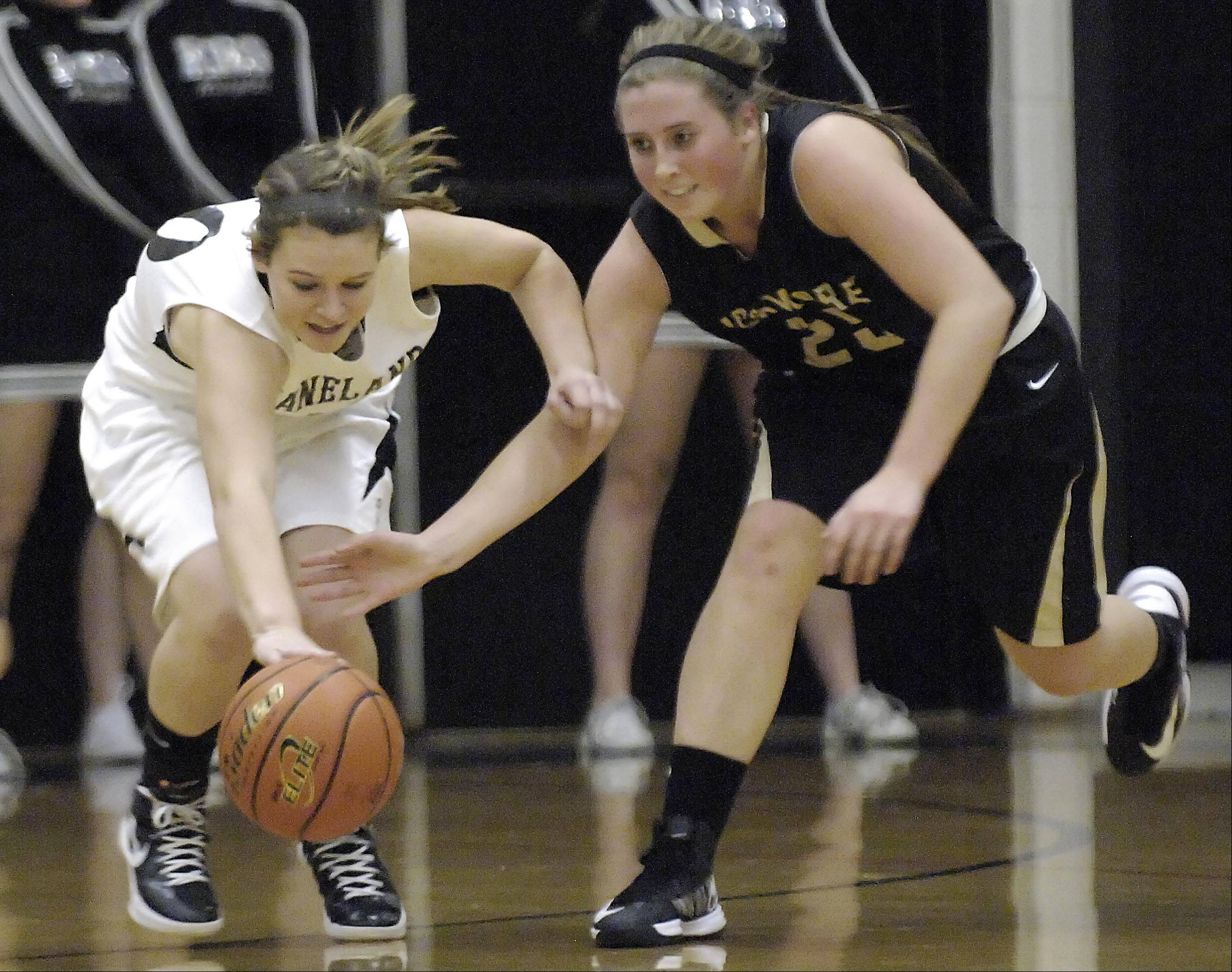 Kaneland�s Allyson O�Herron gets to a loose ball ahead of Sycamore�s Bailey Gilbert.