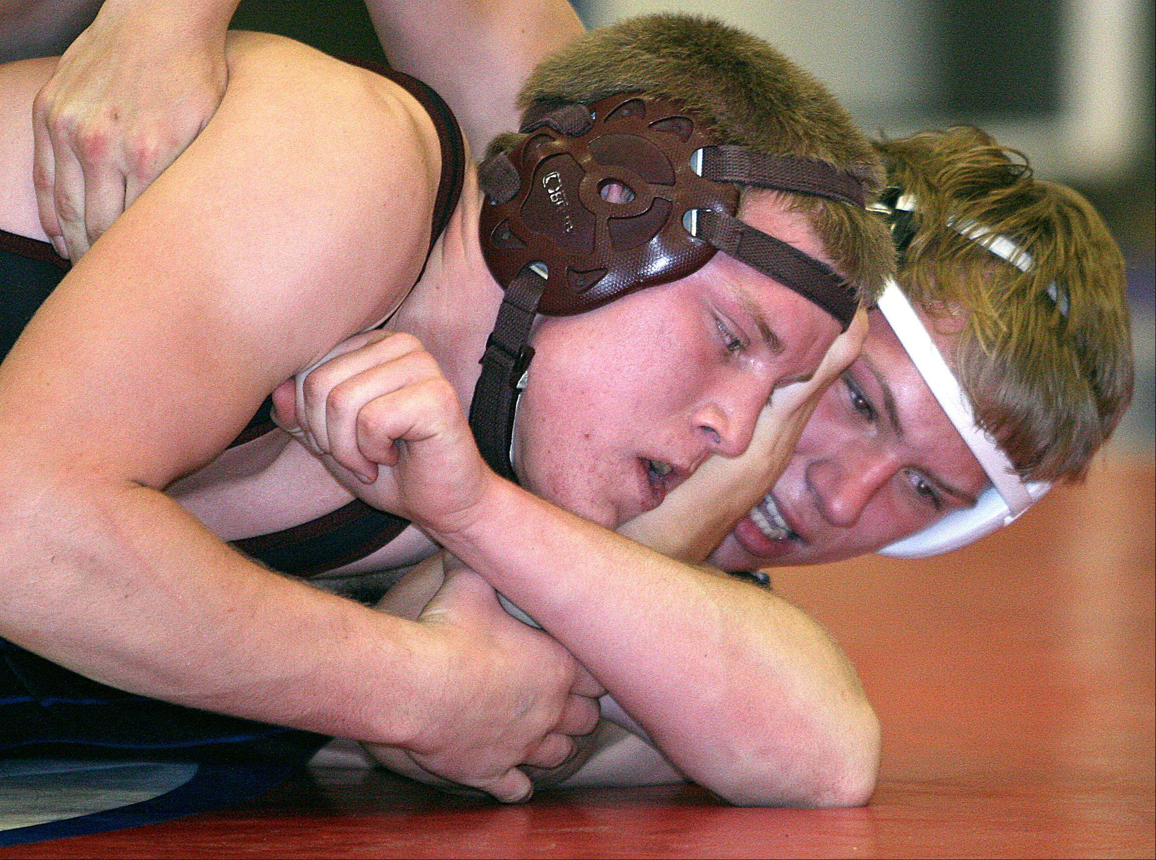 Prairie Ridge�s Dylan Wisser, left, battles Dundee-Crown�s Jarrod Rapp, right, in their 182-pound match at Carpentersville Thursday night. Rapp won the match.