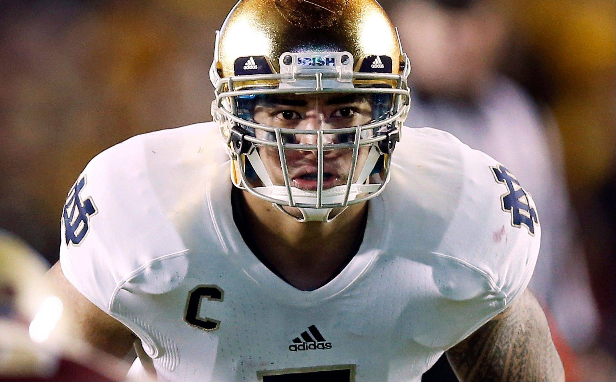 FILE - In this Nov. 10, 2012, file photo, Notre Dame linebacker Manti Te'o waits for the snap during the second half of Notre Dame's 21-6 win over Boston College in a NCAA college football game in Boston. Te'o is a finalist for the Heisman Trophy. (AP Photo/Winslow Townson, File)