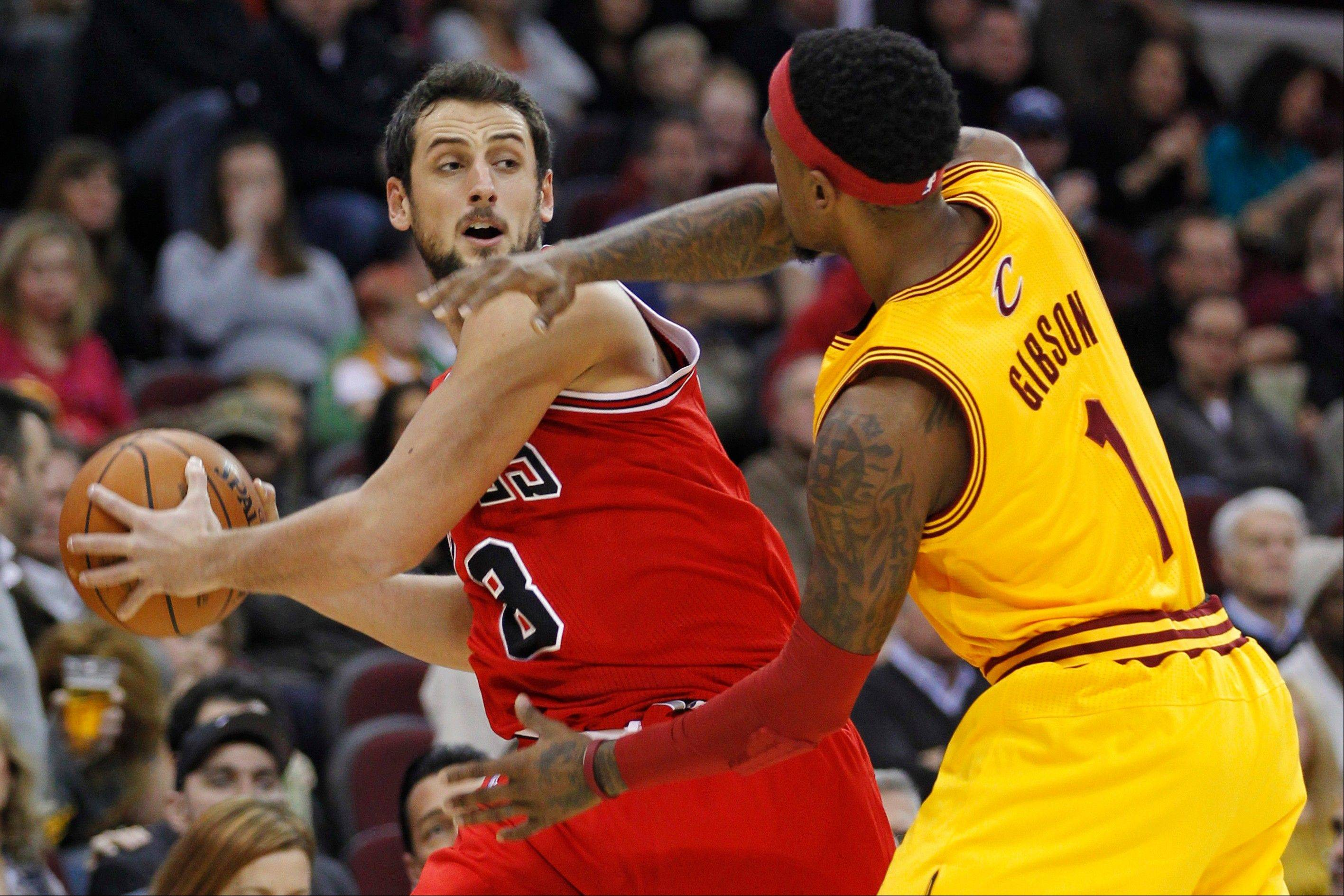 The Bulls� Marco Belinelli is pressured by Cleveland�s Daniel Gibson in the first quarter Wednesday night in Cleveland. Belinelli finished with 23 points in the Bulls� 95-85 victory.