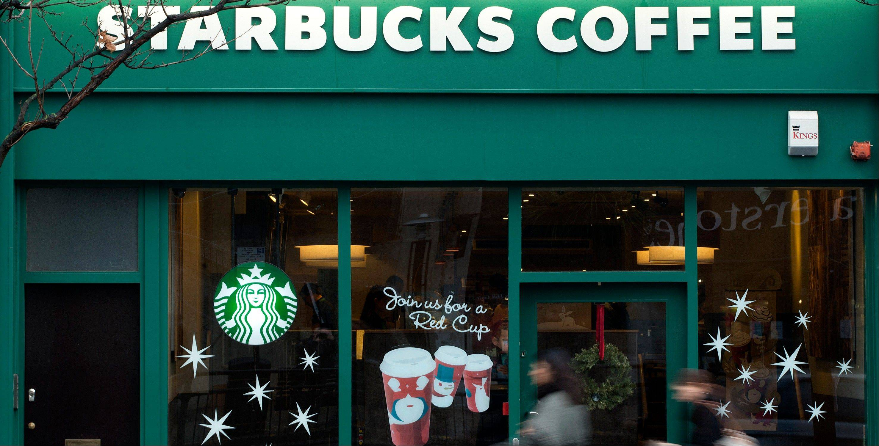 Starbucks bowed to mounting pressure over its tax affairs in Britain and revealed Thursday Dec. 6, 2012 that it would pay about $16 million in each of the next two years.