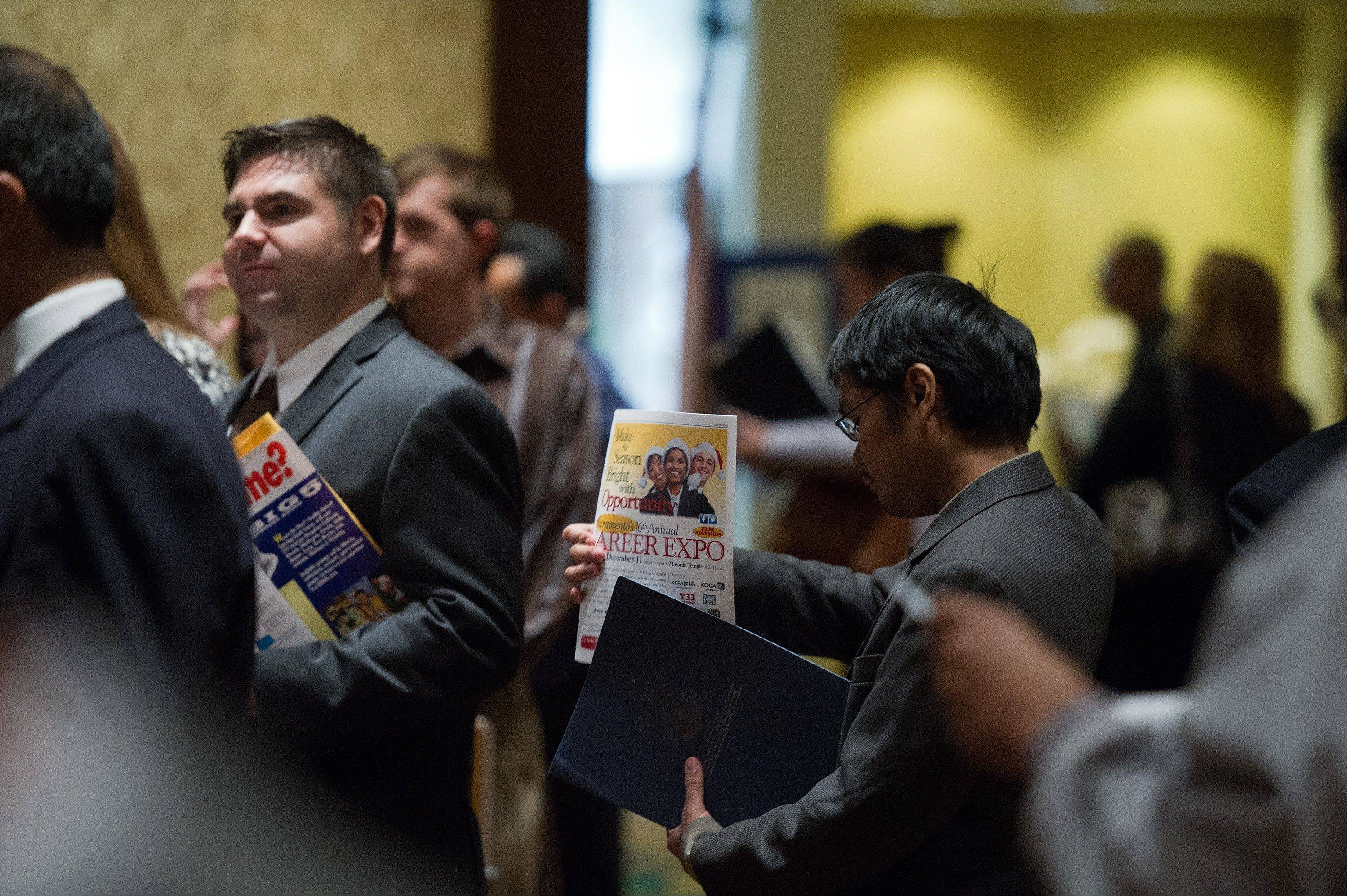 Job seekers wait to speak to recruiters during a job fair in San Jose, California, earlier this week.