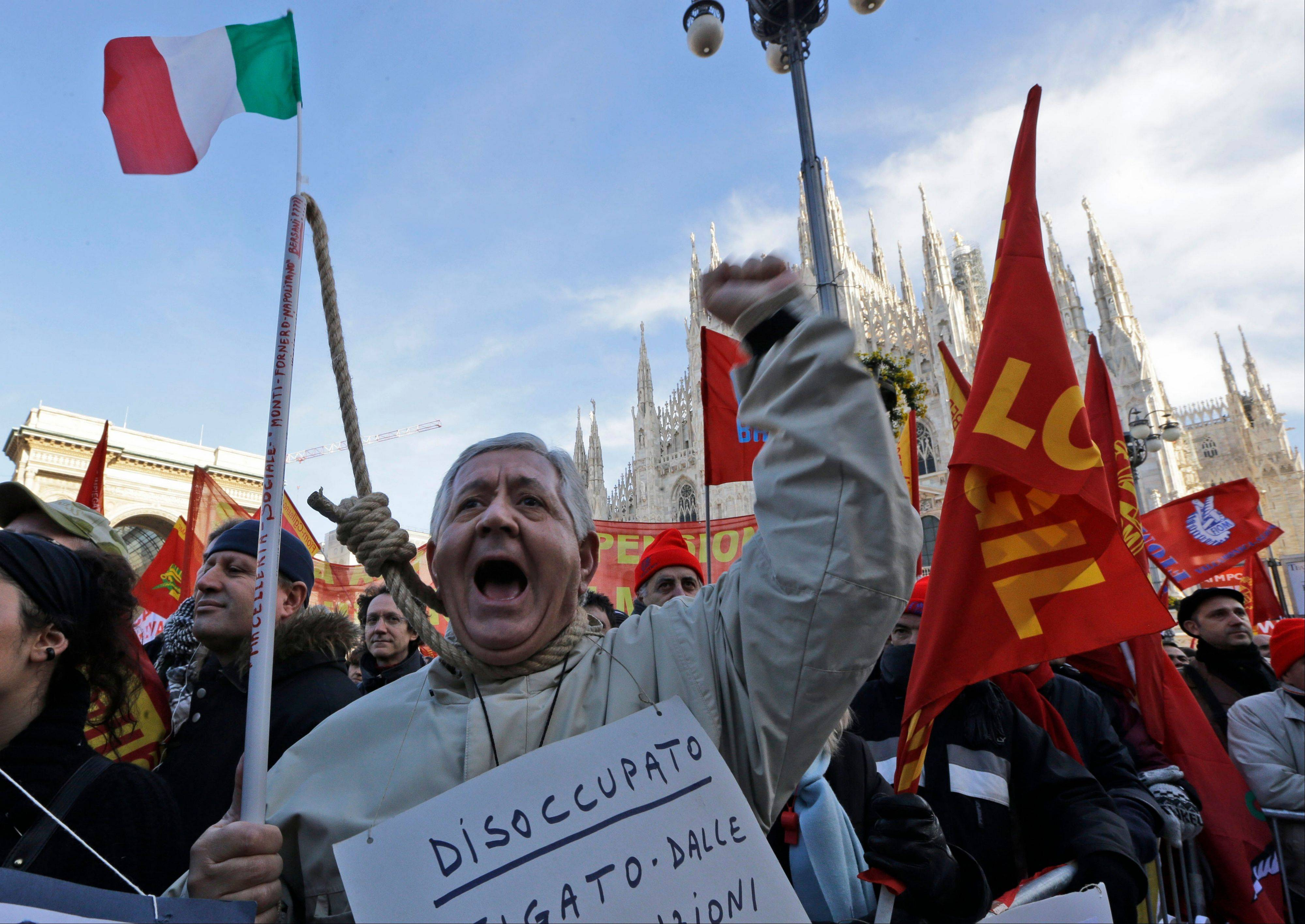 "A protester wearing a sign reading ""unemployed"" shouts slogans during a metalworkers protest in front of the Duomo gothic cathedral, in Milan, Italy, Wednesday."