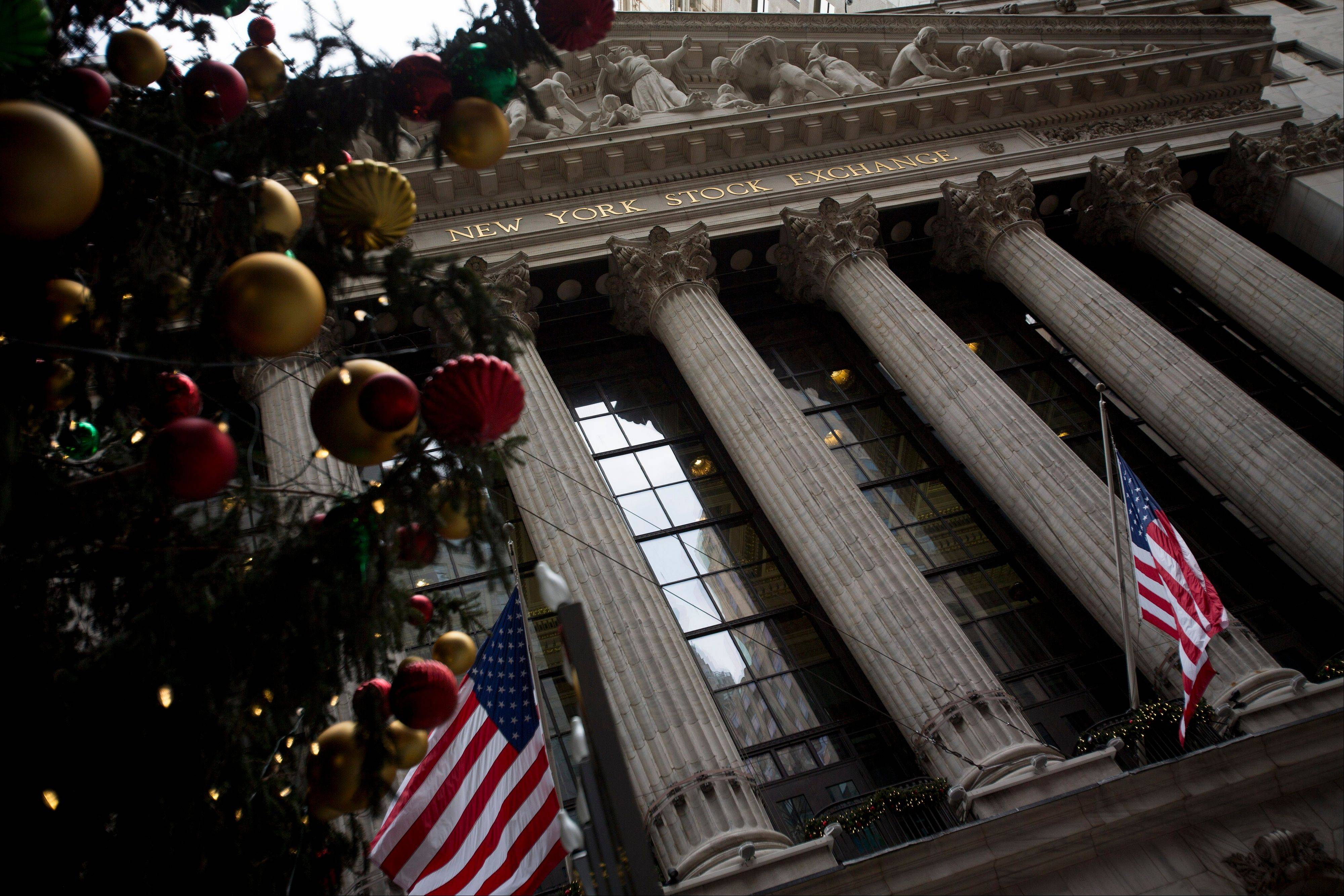 Christmas decorations and U.S. flags are displayed outside of the New York Stock Exchange in New York, Wednesday.