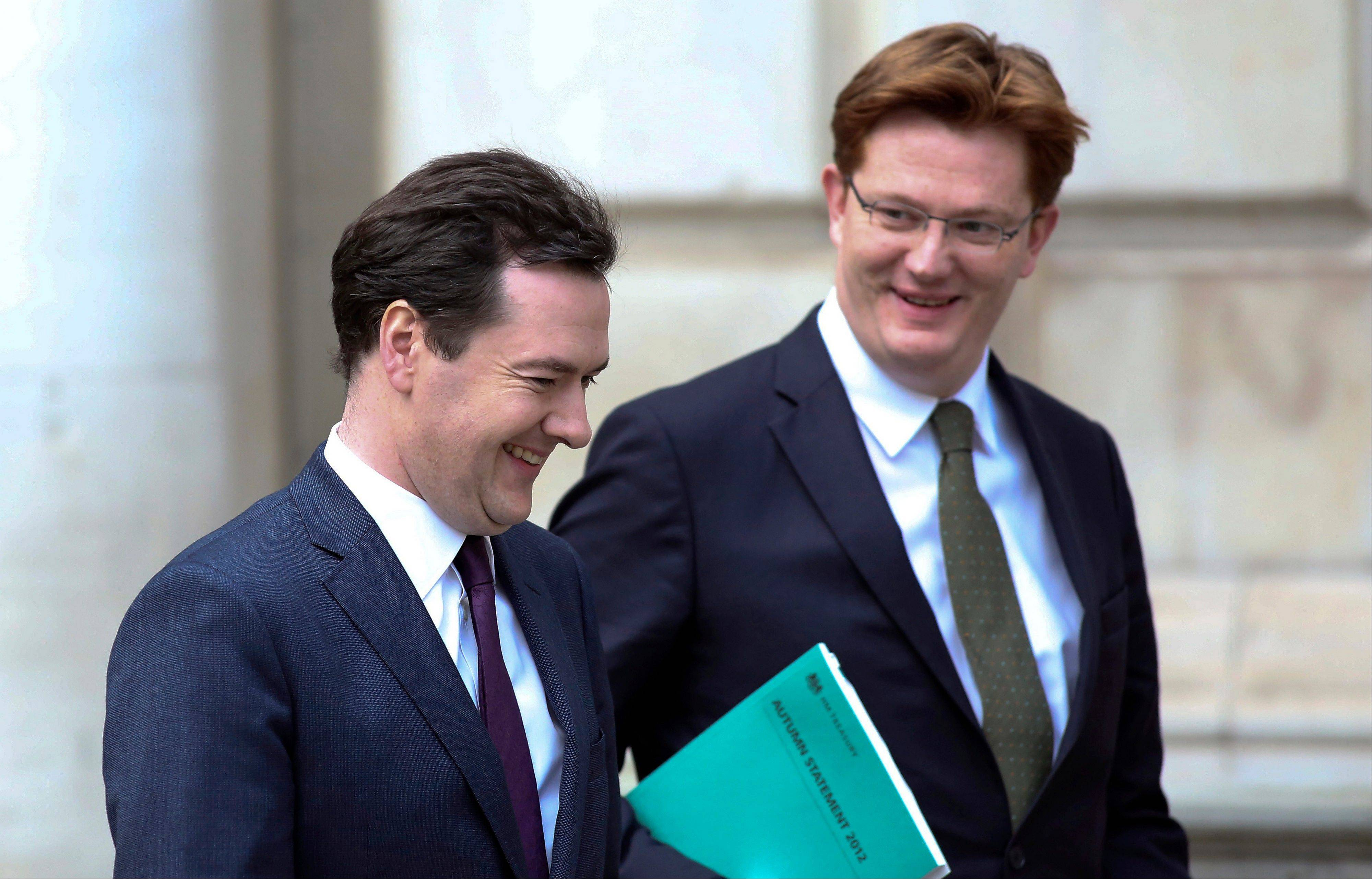 George Osborne, U.K. chancellor of the exchequer, left, reacts with Danny Alexander, U.K. chief secretary to the treasury, as they leave the HM Treasury building for the Houses of Parliament in London, U.K., Wednesday. Osborne faces the prospect of breaching his self-imposed budget rules as an economy struggling to escape recession drives debt higher and erodes his political capital.