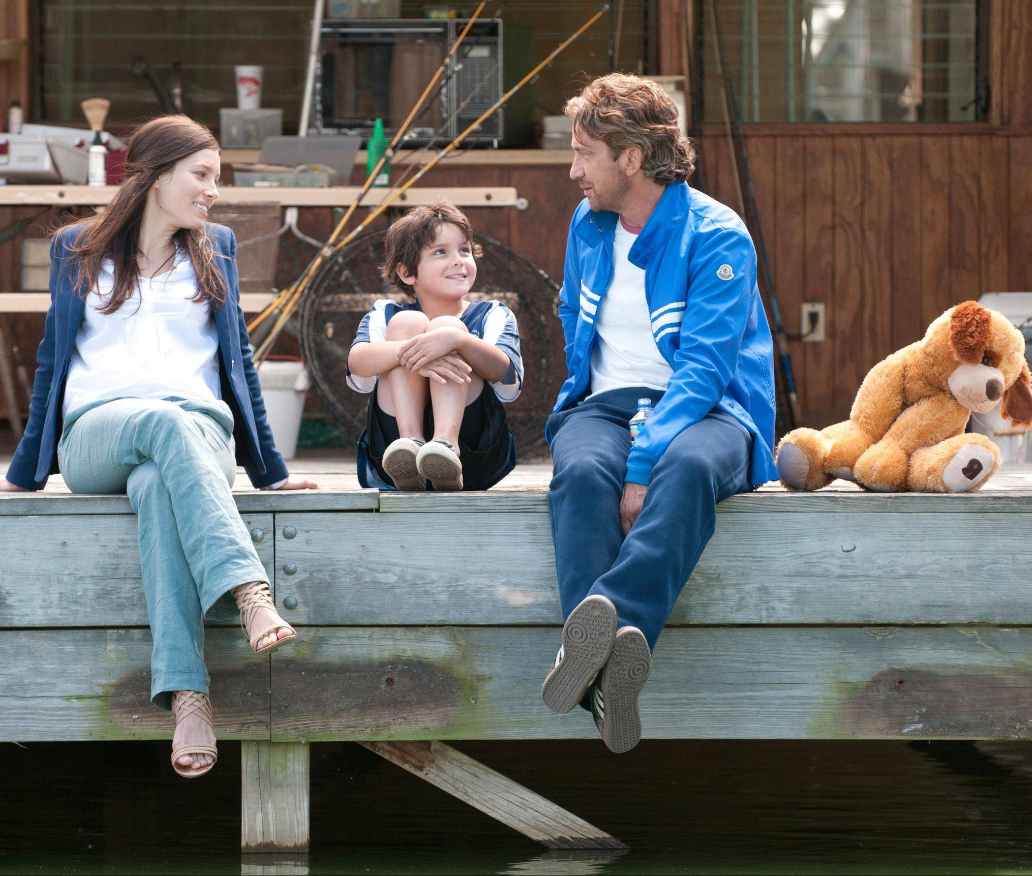 "Stacie (Jessica Biel), Lewis (Noah Lomax) enjoy a nice moment with former soccer superstar George (Gerard Butler) in the romantic sports comedy ""Playing for Keeps."""
