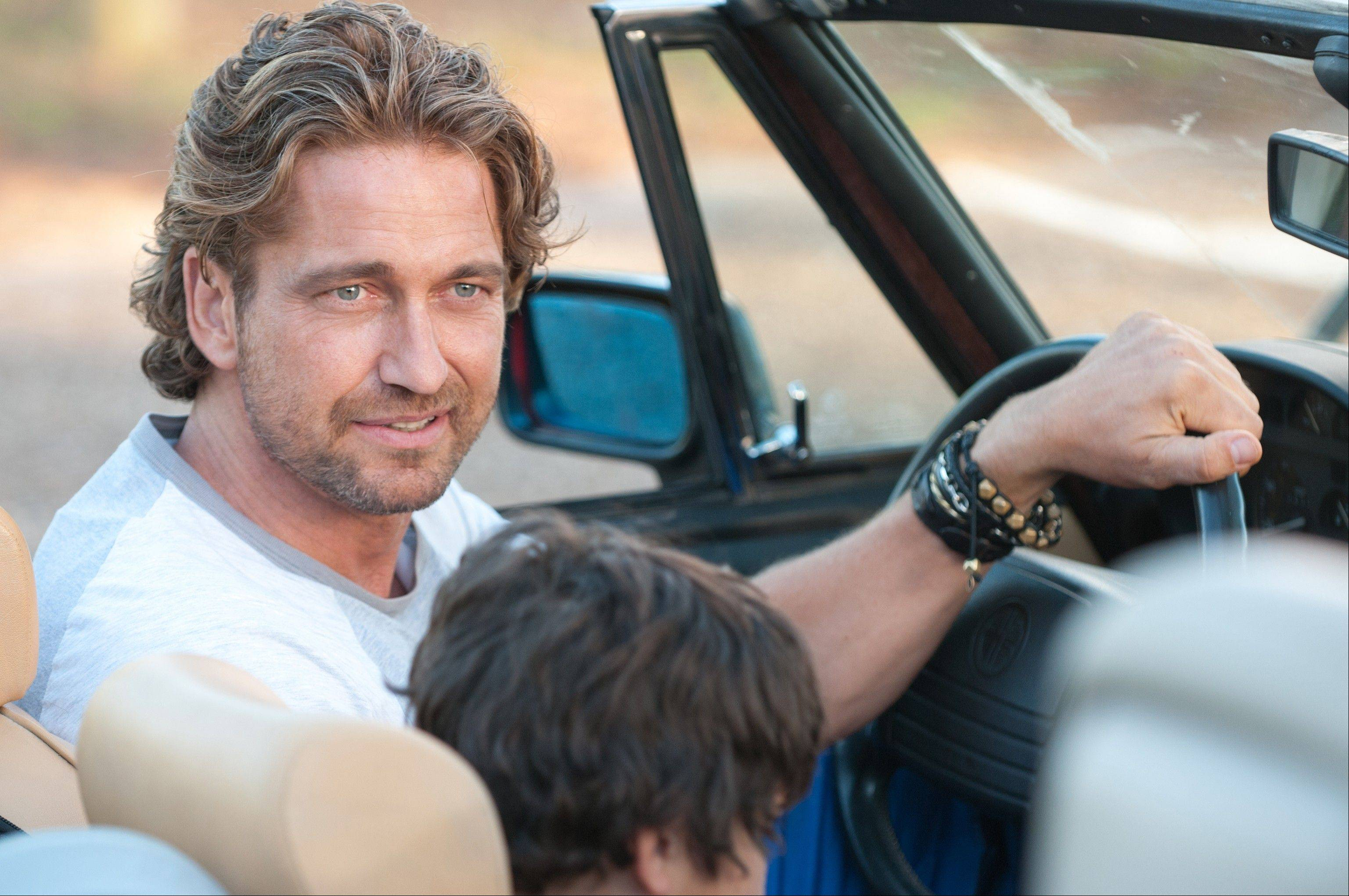 "George (Gerard Butler), a former soccer superstar, has his life changed after he starts coaching his son's soccer team in the romantic sports comedy ""Playing For Keeps."""