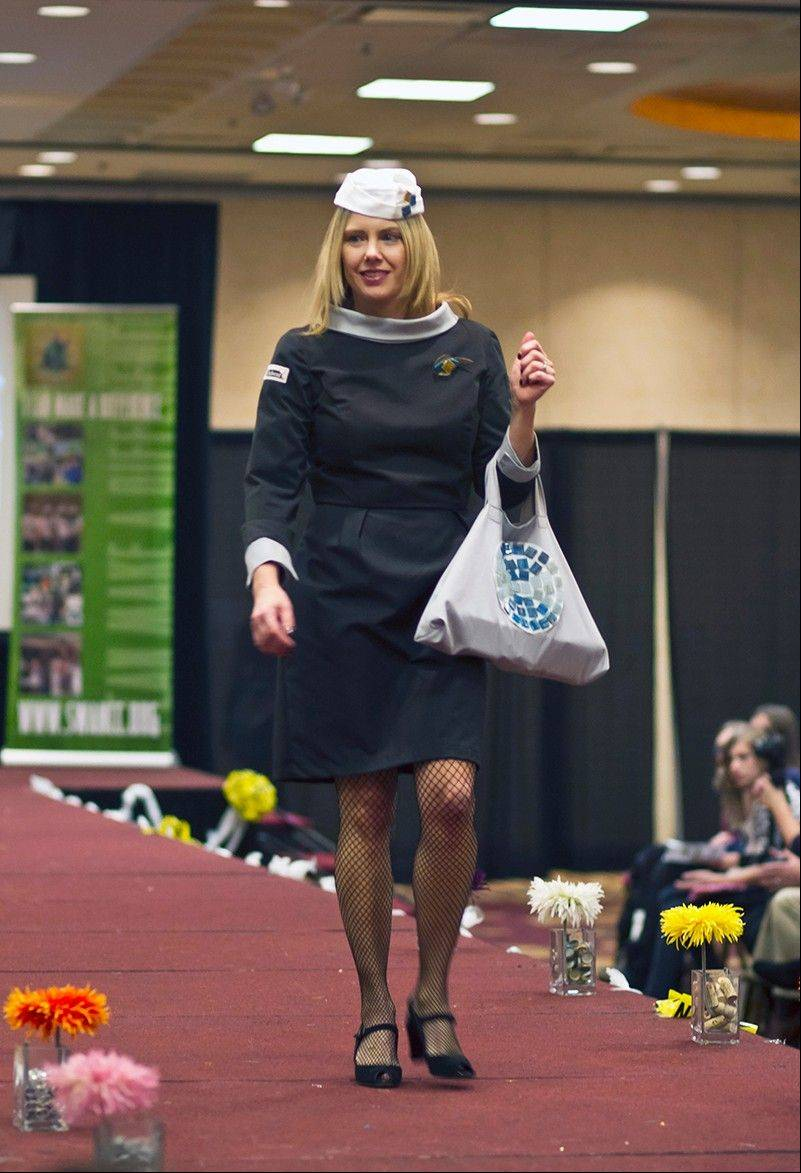 "Niles North High School Family and Consumer Science teacher and project sponsor Julie Lear was inspired by Pan Am flight attendants' uniforms in the movie ""Catch Me If You Can,"" movie for her creation ""Cookture."" The dress and hat are made from gray and black chef coats, embellished with tile samples. The flight attendant pin is made from a sample piece of leather and tile from interior design store discards."