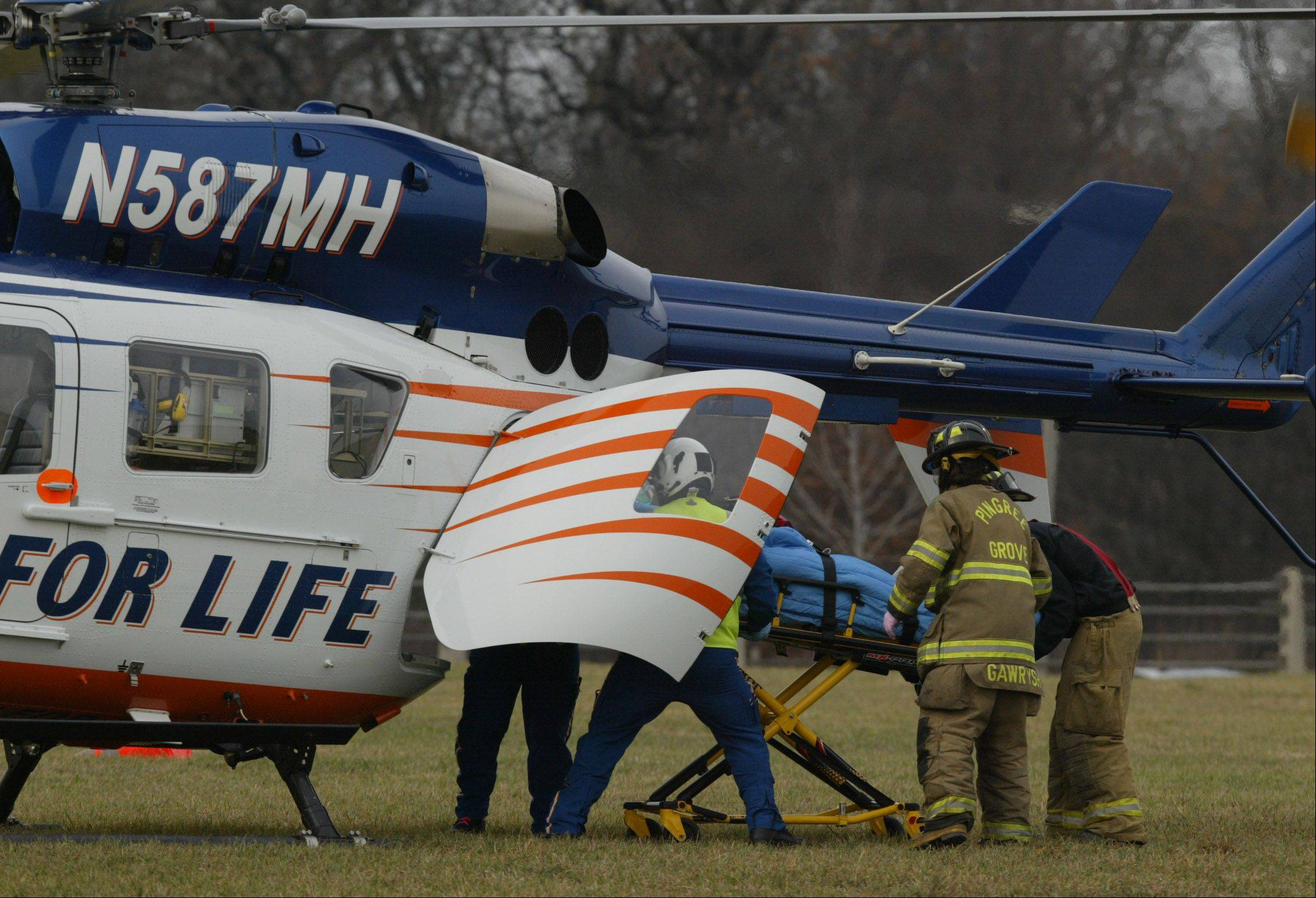 Firefighters and Flight for Life crew members load a 26-year-old Johnsburg man into the helicopter Thursday morning after he was extricated from his vehicle.