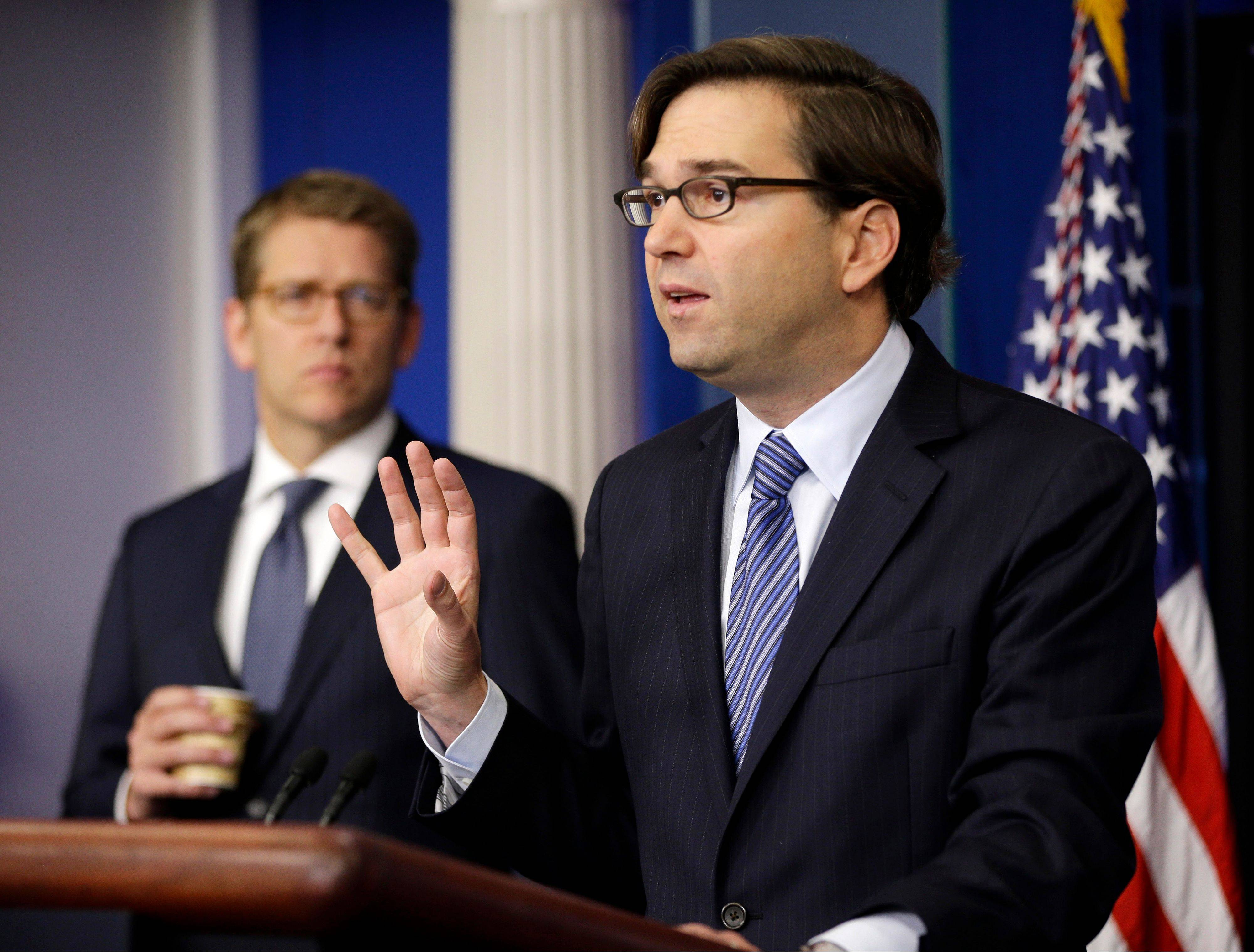 White House press Secretary Jay Carney listens at left as Jason Furman, assistant to the President for Economic Policy and Principal Deputy Director of the National Economic Council, speaks during the daily news briefing at the White House Wednesday.