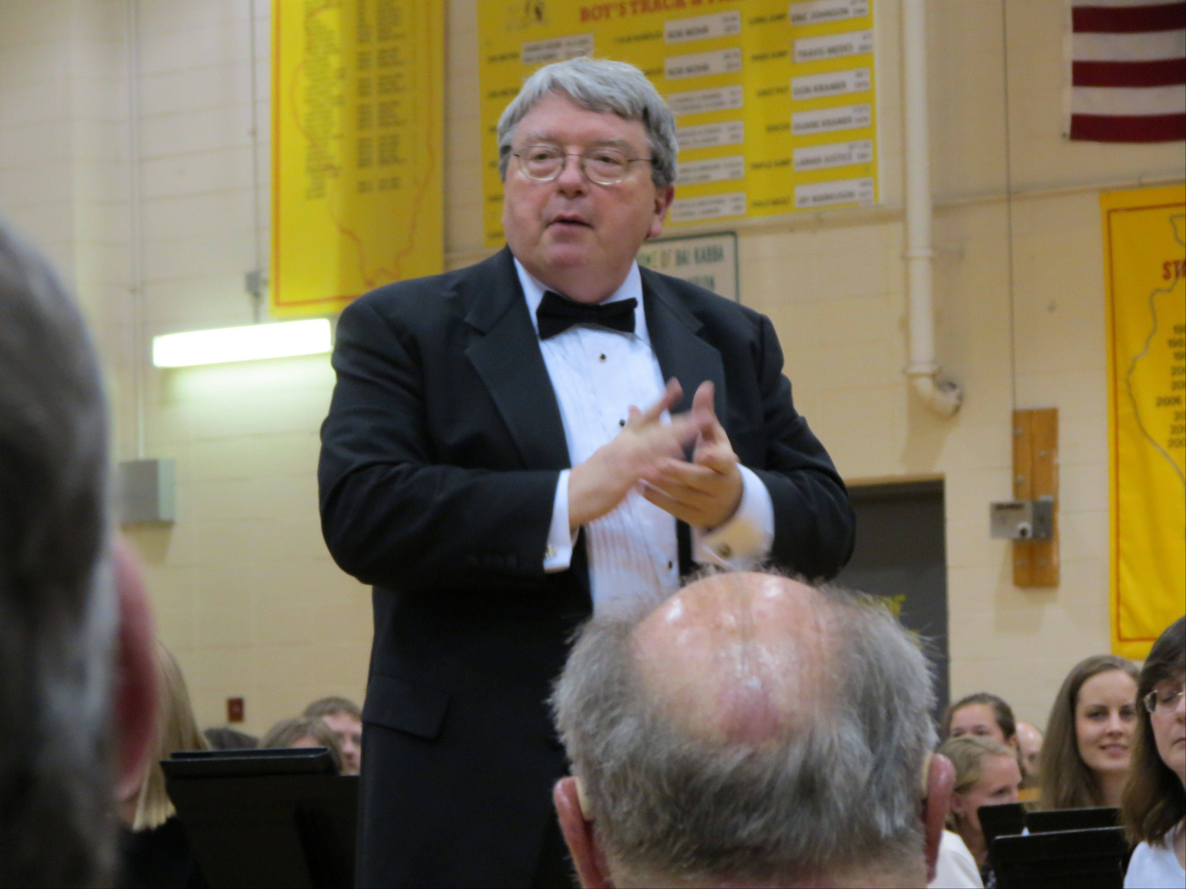 "Retired Batavia High School band director John Heath, shown at an alumni concert at the high school, will lead this year's Do-It-Yourself ""Messiah,"" a fundraiser for STAGE, at the Batavia Fine Arts Centre Sunday, Dec. 9."