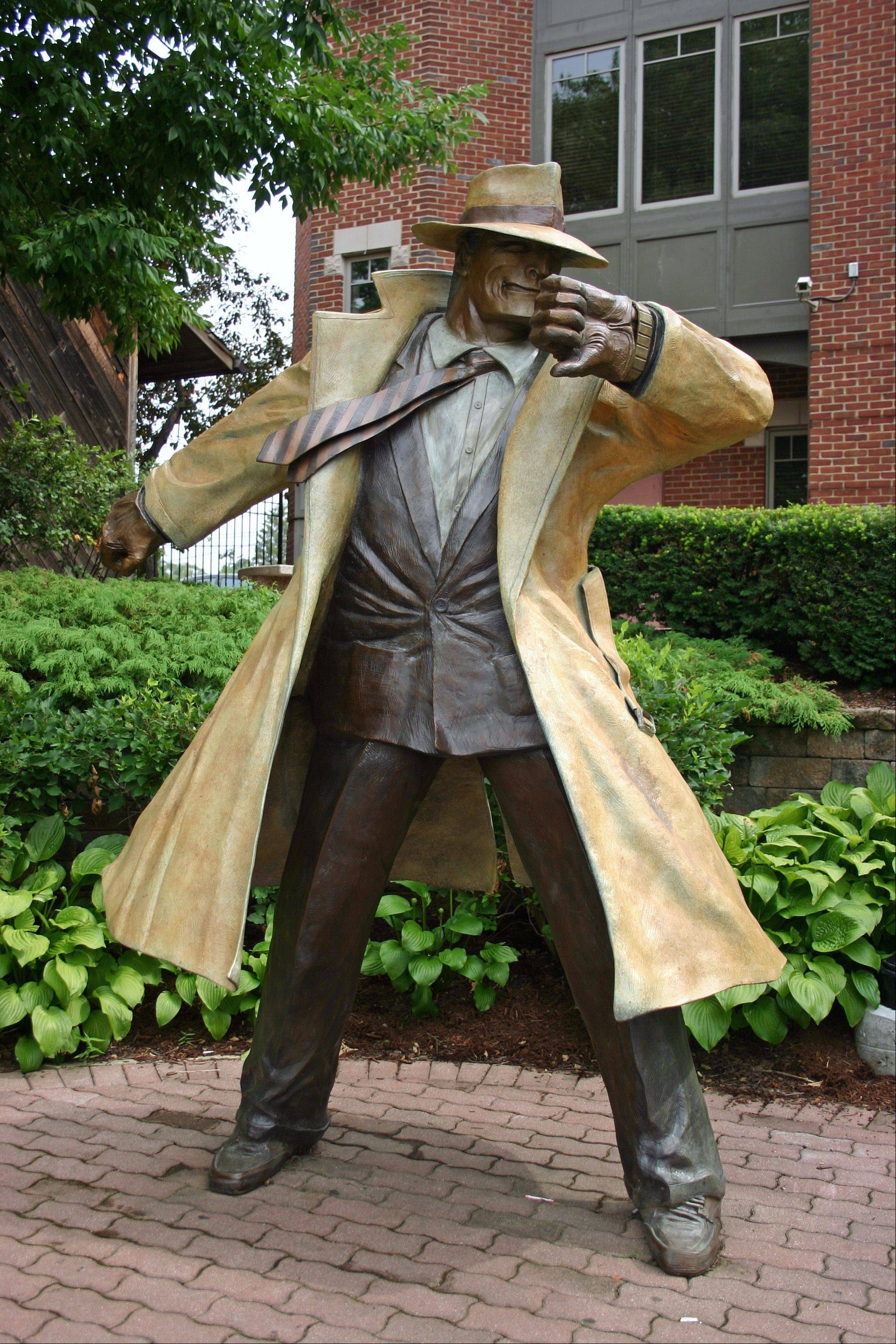 Dick Tracy on the Naperville Riverwalk is part of the Century Walk public art project, about which you can now watch videos thanks to QR codes.