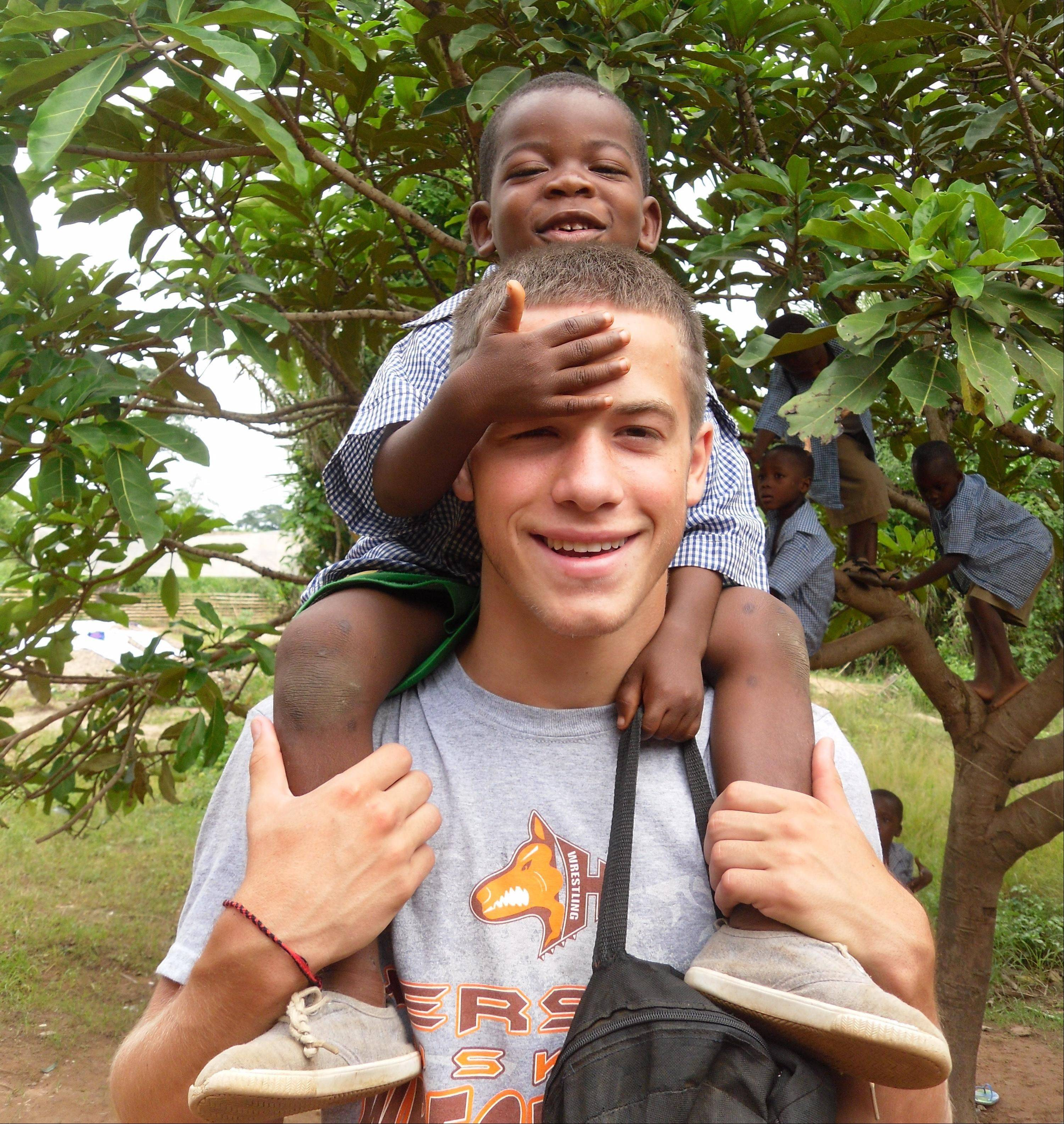 Hersey High School student Alex Baratta, 17, goofs around with one of the children he taught during a volunteer trip to Ghana.
