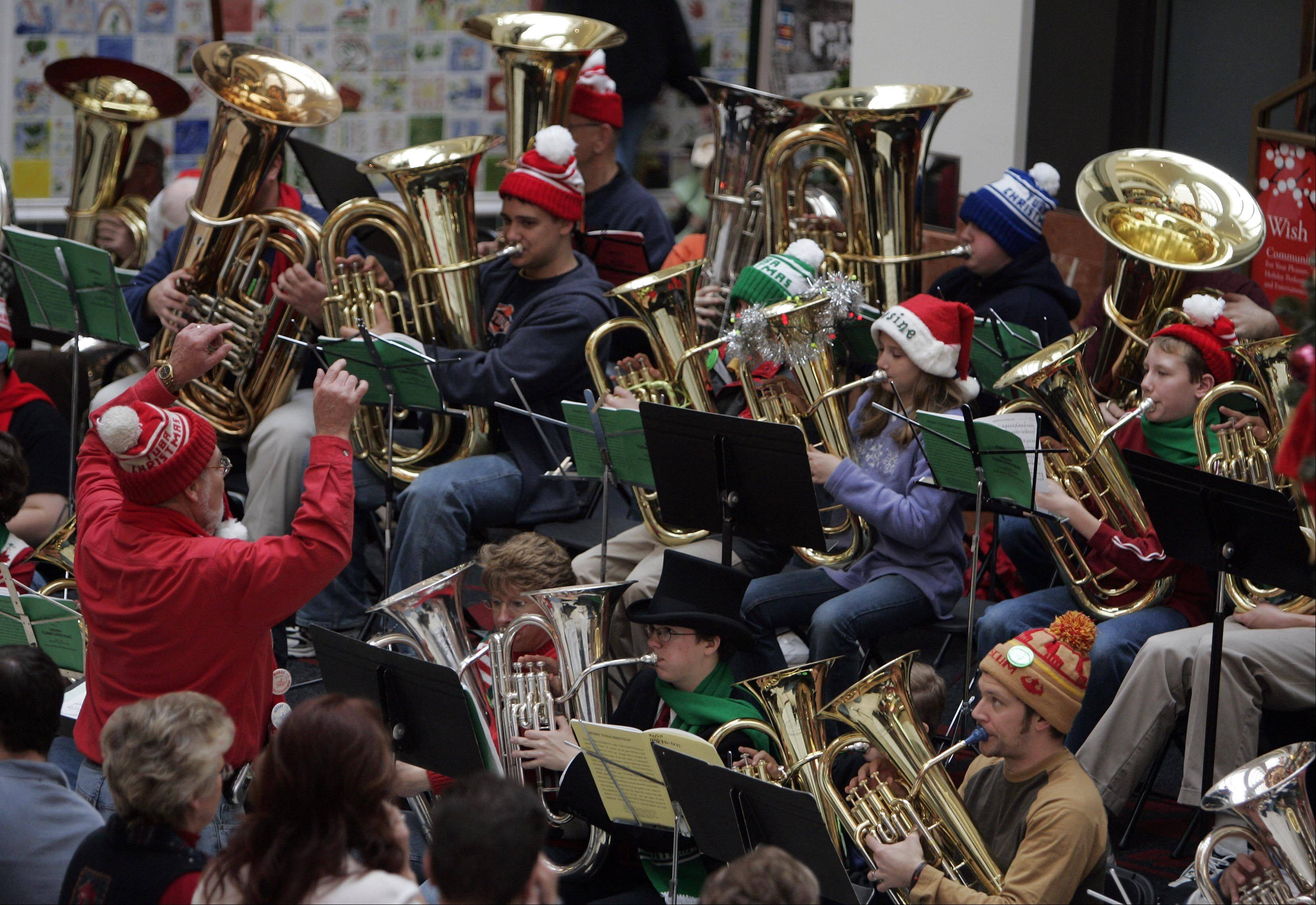 Dozens of tuba players will gather Saturday in Naperville and Aurora under the direction of Naperville Municipal Band Director Ron Keller for their annual Tuba Christmas concerts.