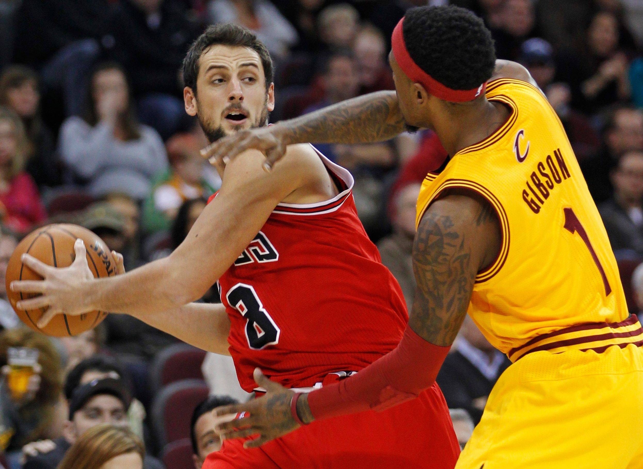 Marco Belinelli is pressured by Cleveland's Daniel Gibson on Wednesday. Belinelli scored a season-high 23 points and hit 7 of 15 field goals.