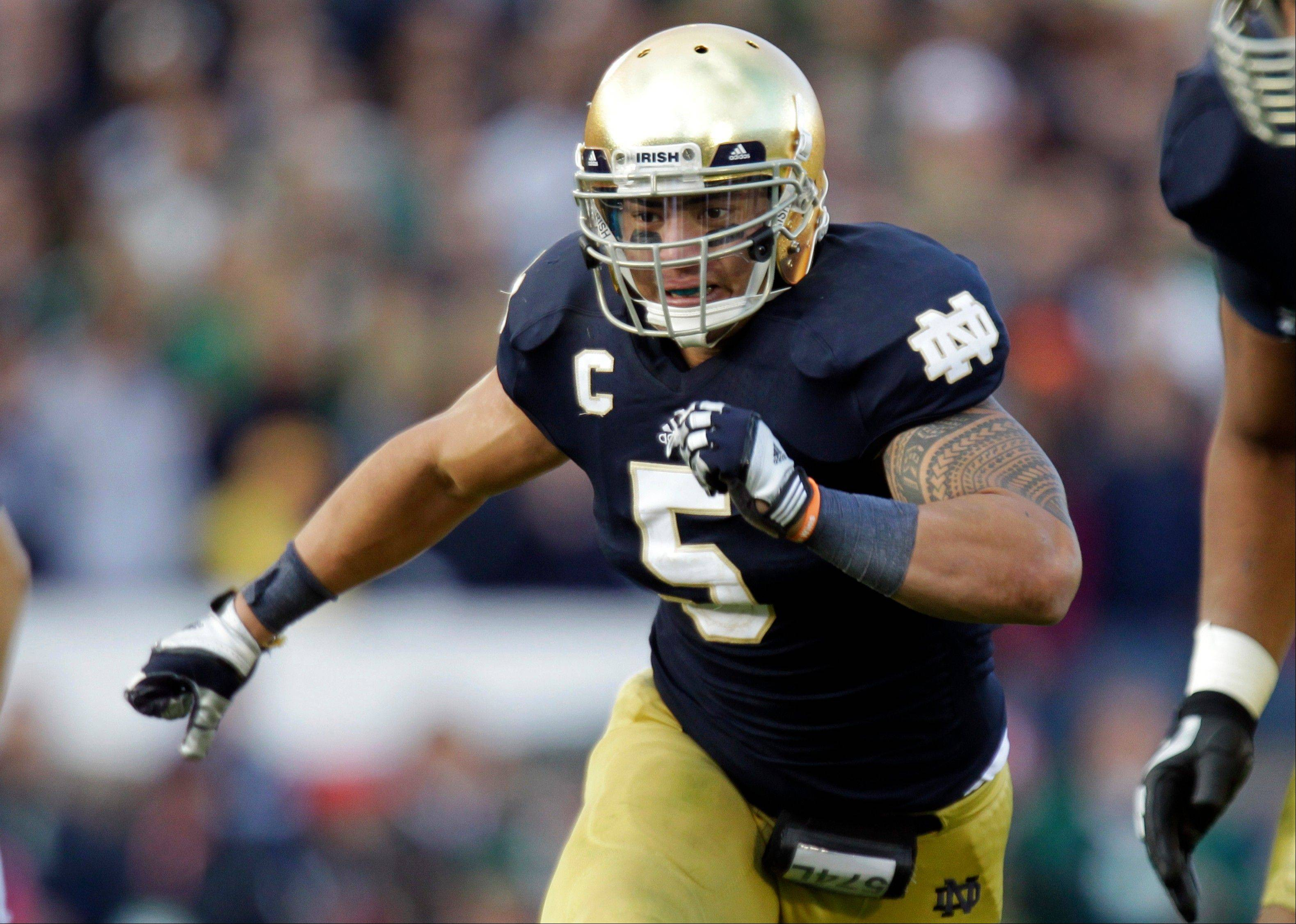 Notre Dame linebacker Manti Te'o plays against BYU in South Bend, Ind. Te'o is a finalist for the Heisman Trophy.