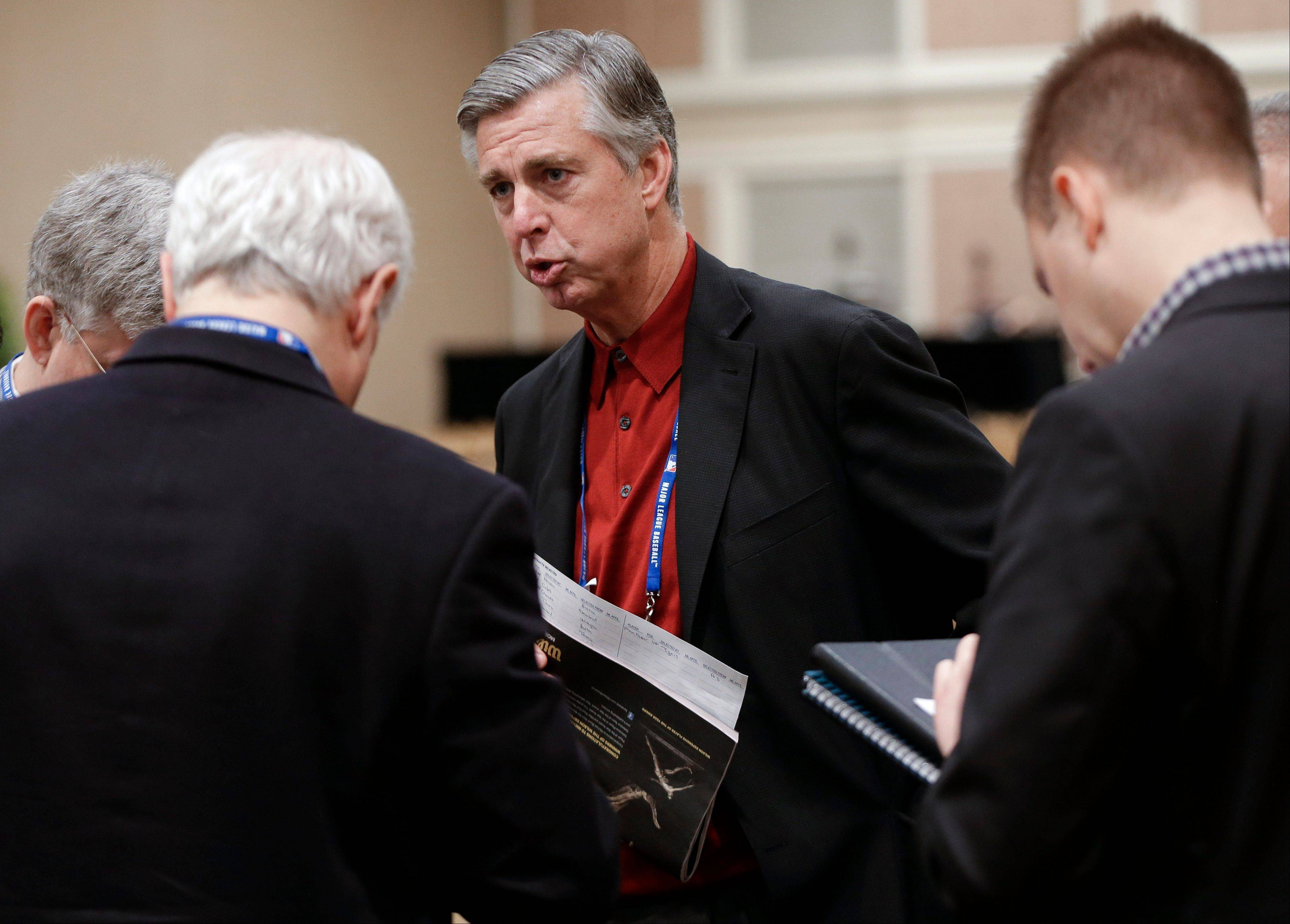 Detroit Tigers general manager David Dombrowski, center, talks with reporters Thursday following the Rule 5 draft at the baseball winter meetings in Nashville, Tenn.