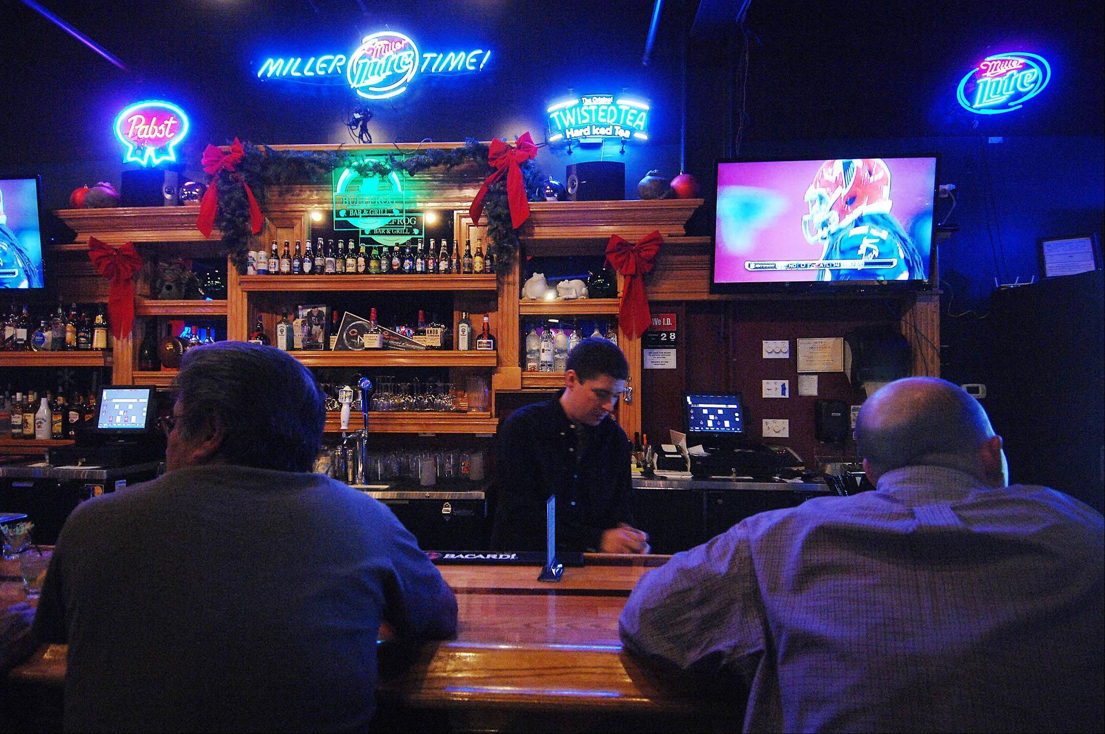 Bartender Mike Morrison pours drinks at the Chubby Bullfrog in West Dundee.