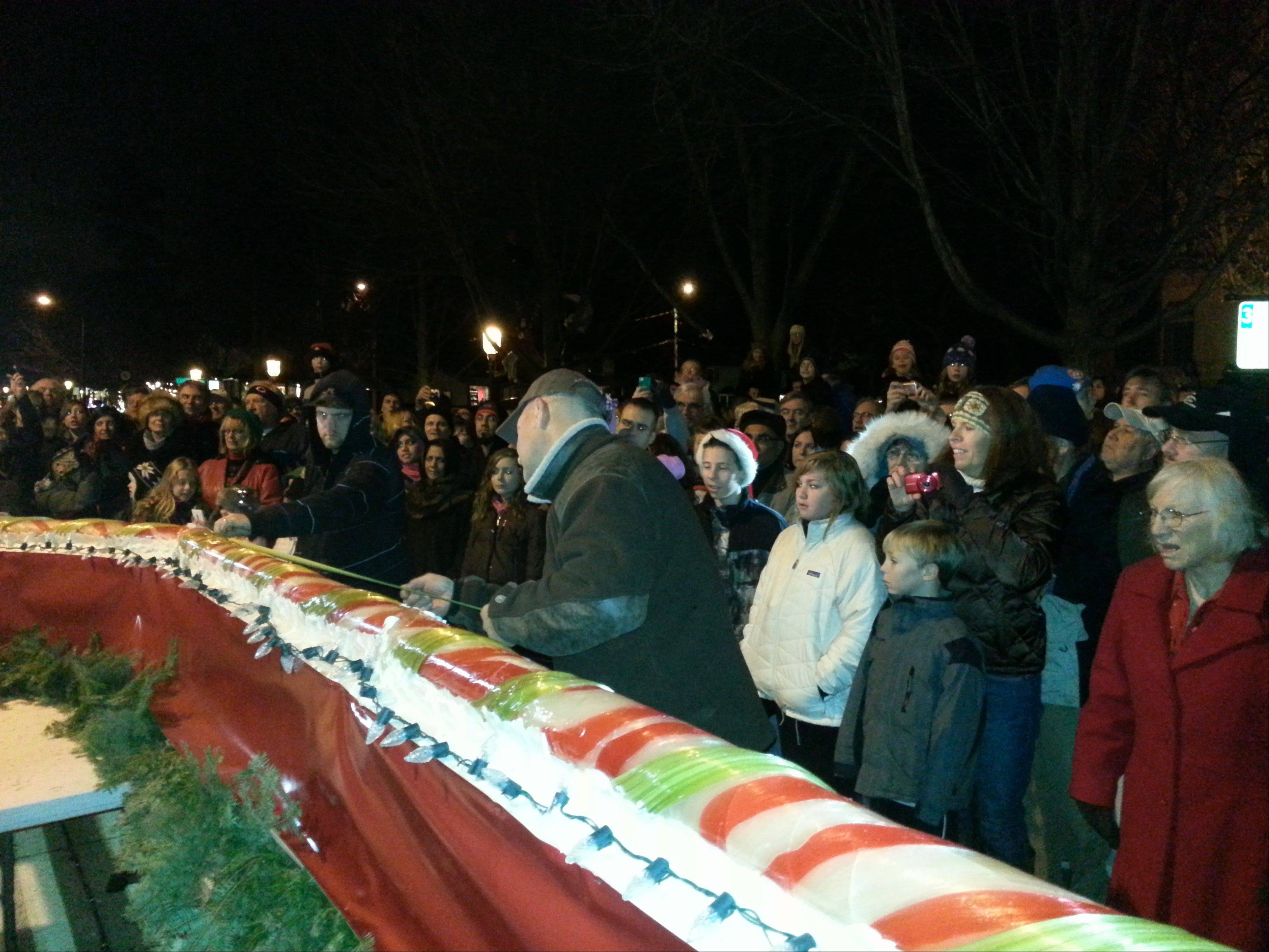 Chef Alain Roby breaks the record for the world�s longest candy cane � measured at 51 feet � Saturday night in Geneva.