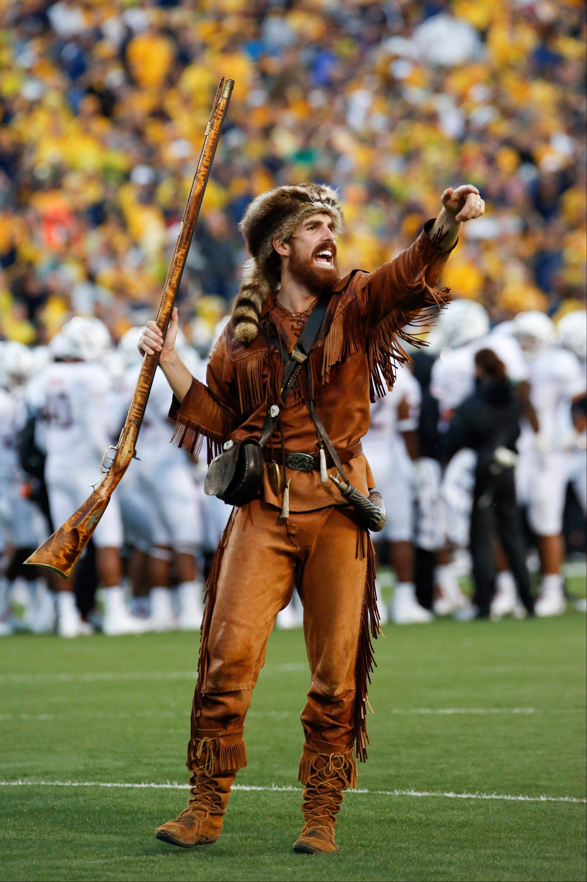 West Virginia University Mountaineer mascot Jonathan Kimble is seen during the NCAA college football game between West Virginia University and University of Maryland in Morgantown, W.Va. A video showing Kimble using his mascot rifle to hunt bear has gone viral.