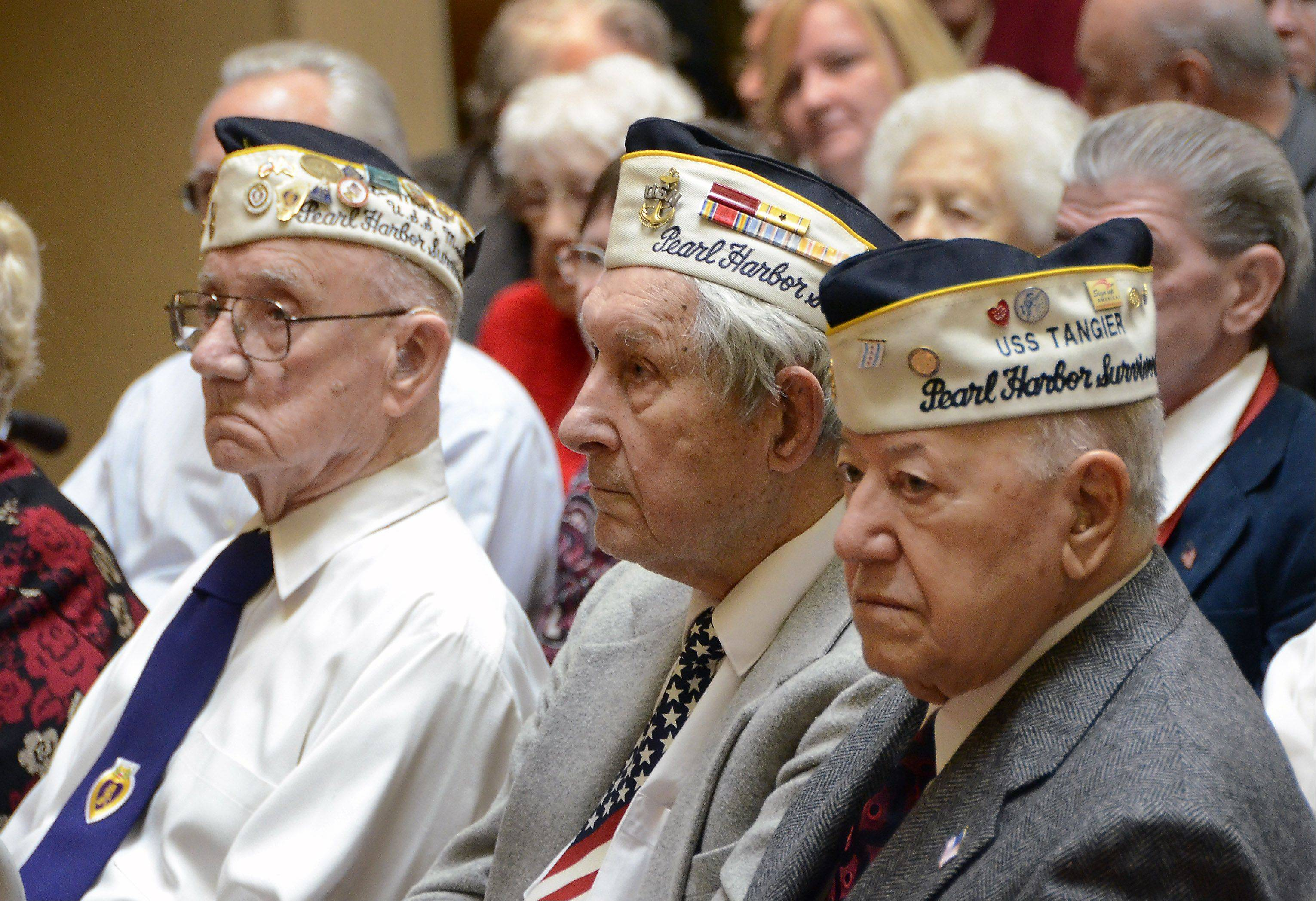Pearl Harbor attack survivors Ed Block of LaGrange, who was on the USS Medusa; James Lyle Hancock of Skokie, who worked in the Navy Yard Dispensary; and Joe Triolo of Waukegan, who was on the USS Tangier, listen to speakers at a remembrance ceremony Friday, Dec. 7, at Oakton Place retirement home in Des Plaines.