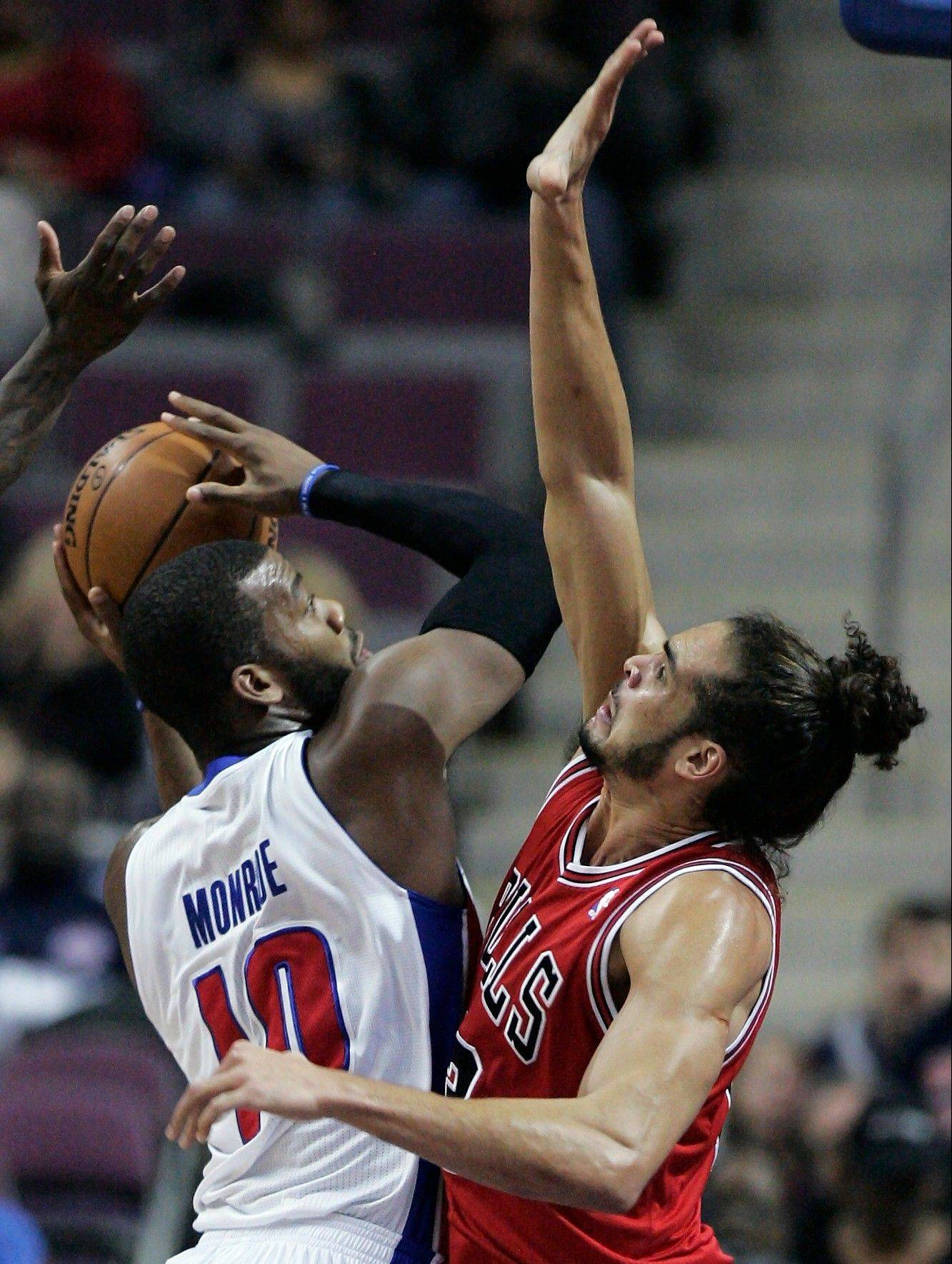 The Pistons� Greg Monroe runs into defensive pressure from the Bulls� Joakim Noah on Friday.
