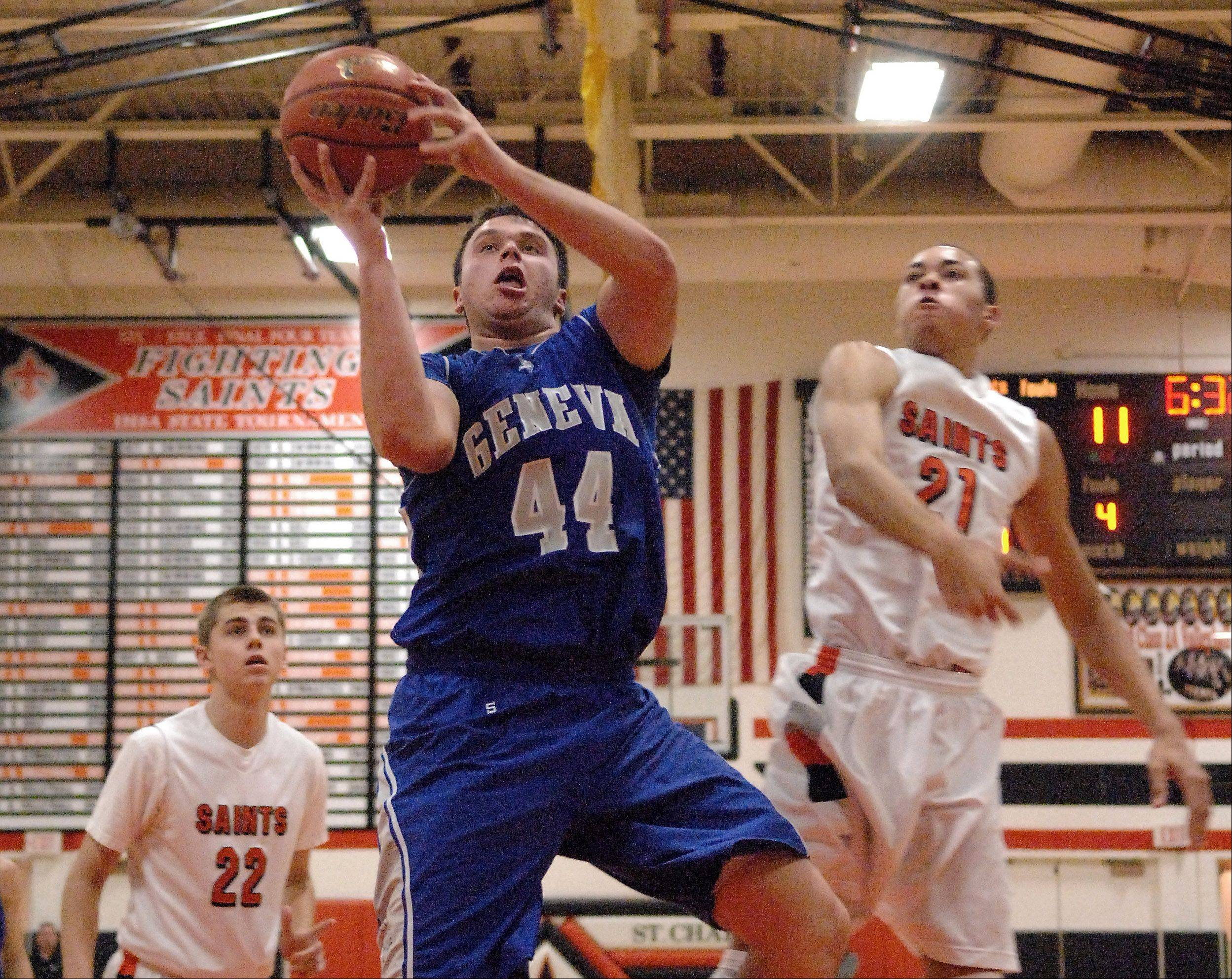 Geneva�s Connor Chapman goes in for a layup against St. Charles East.