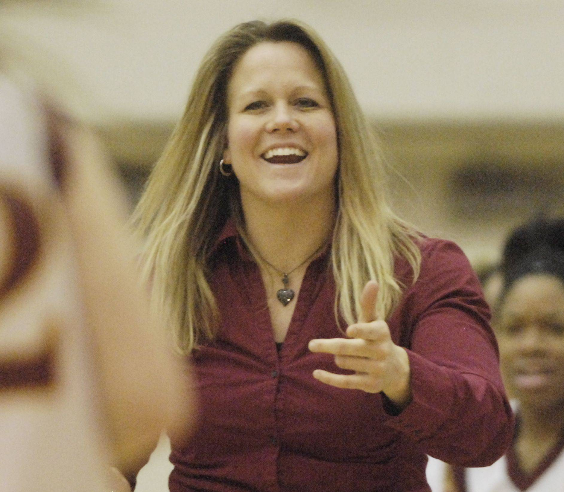 Schaumburg girls basketball coach Ashley Berggren will be inducted into the Illinois Basketball Coaches Association Hall of Fame later this season. celebrates with her team after defeating St. Charles East during Tuesday�s regional semifinal at Bartlett High School.