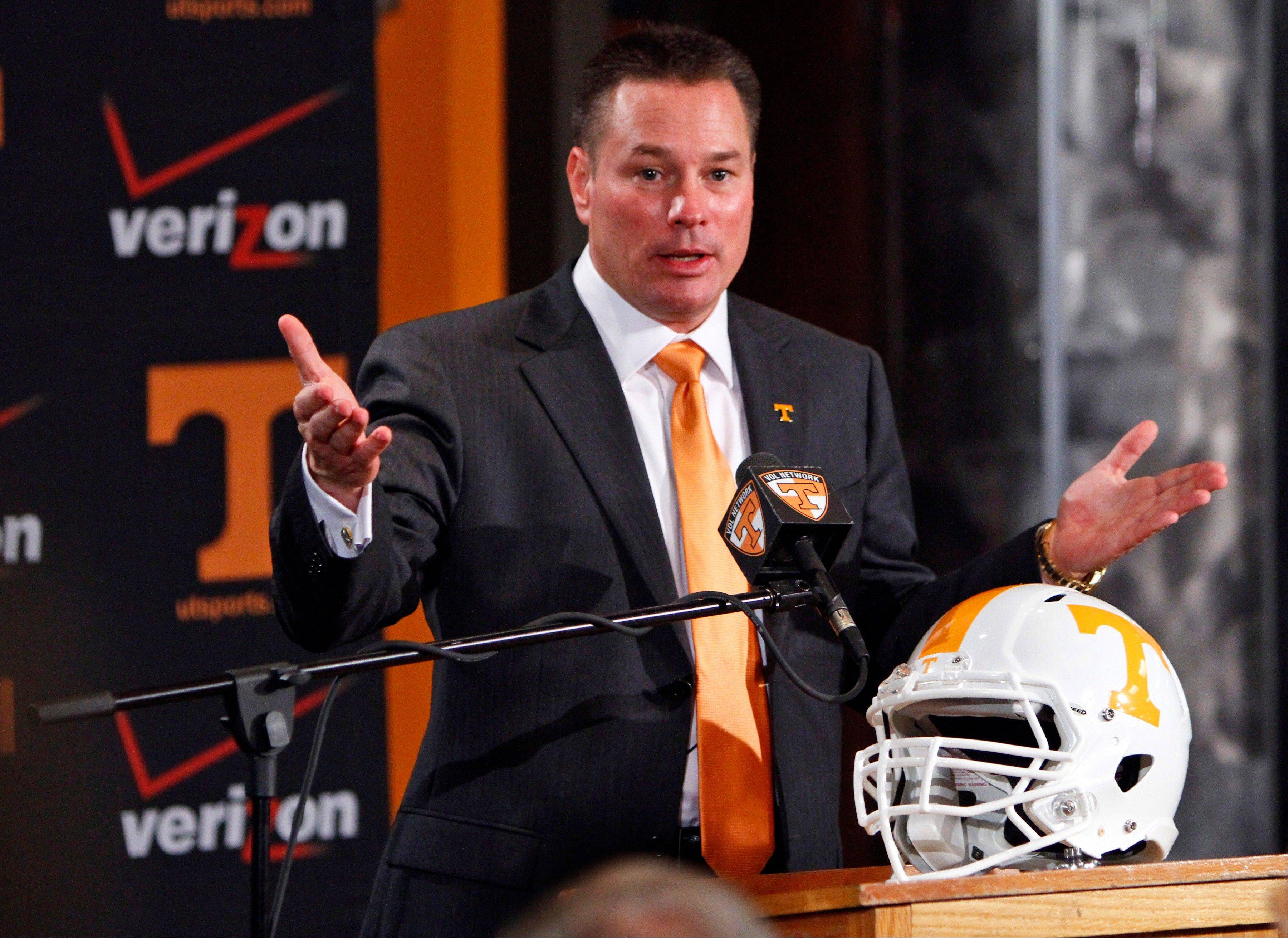Butch Jones, Tennessee�s new head football coach, speaks Friday during a news conference in Knoxville, Tenn. The Vols� introduced Jones on Friday as its successor to Derek Dooley, who was fired Nov. 18 after going 15-21 in three seasons.
