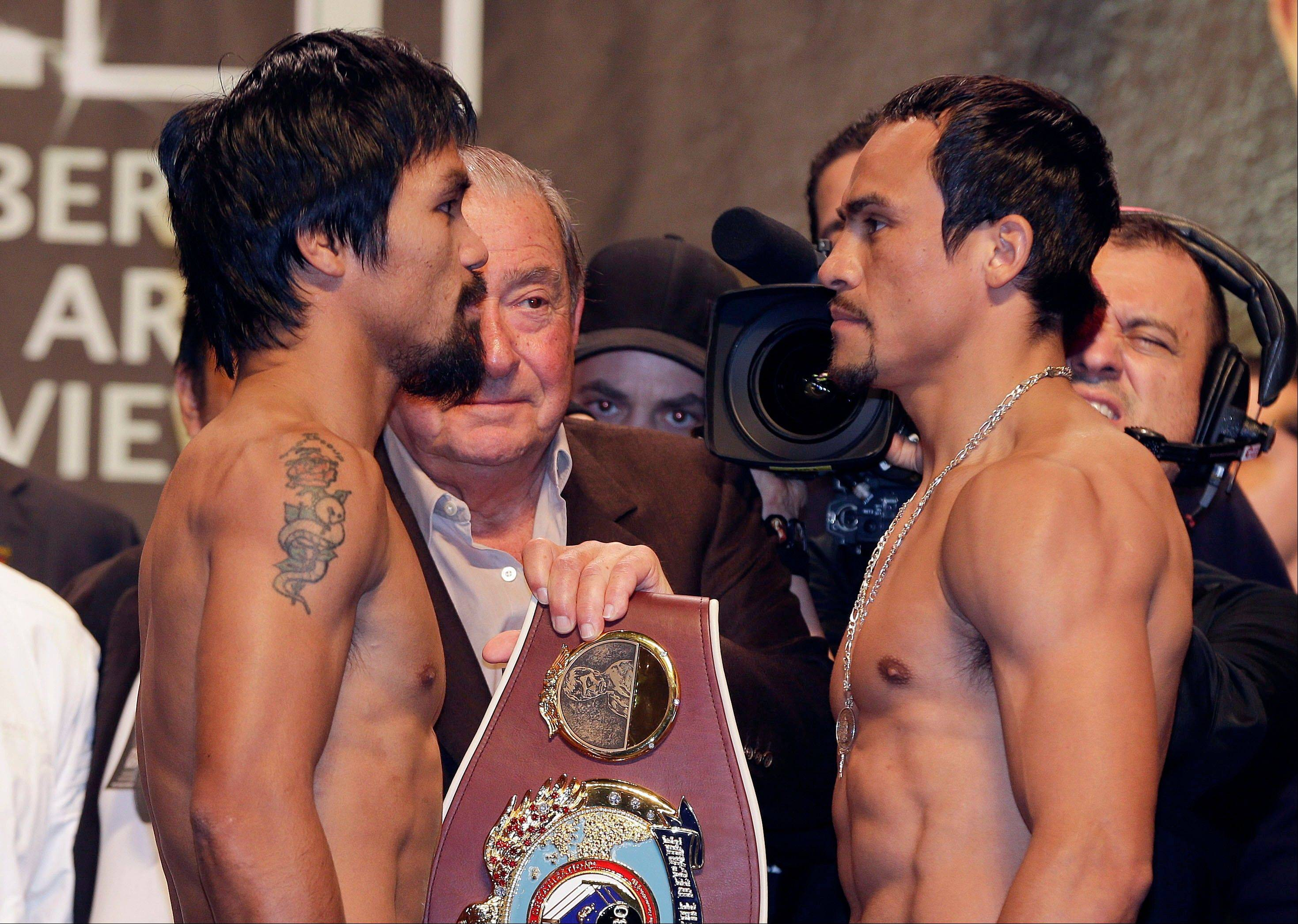 Manny Pacquiao, left, and Juan Manuel Marquez face for the fourth time on Saturday.