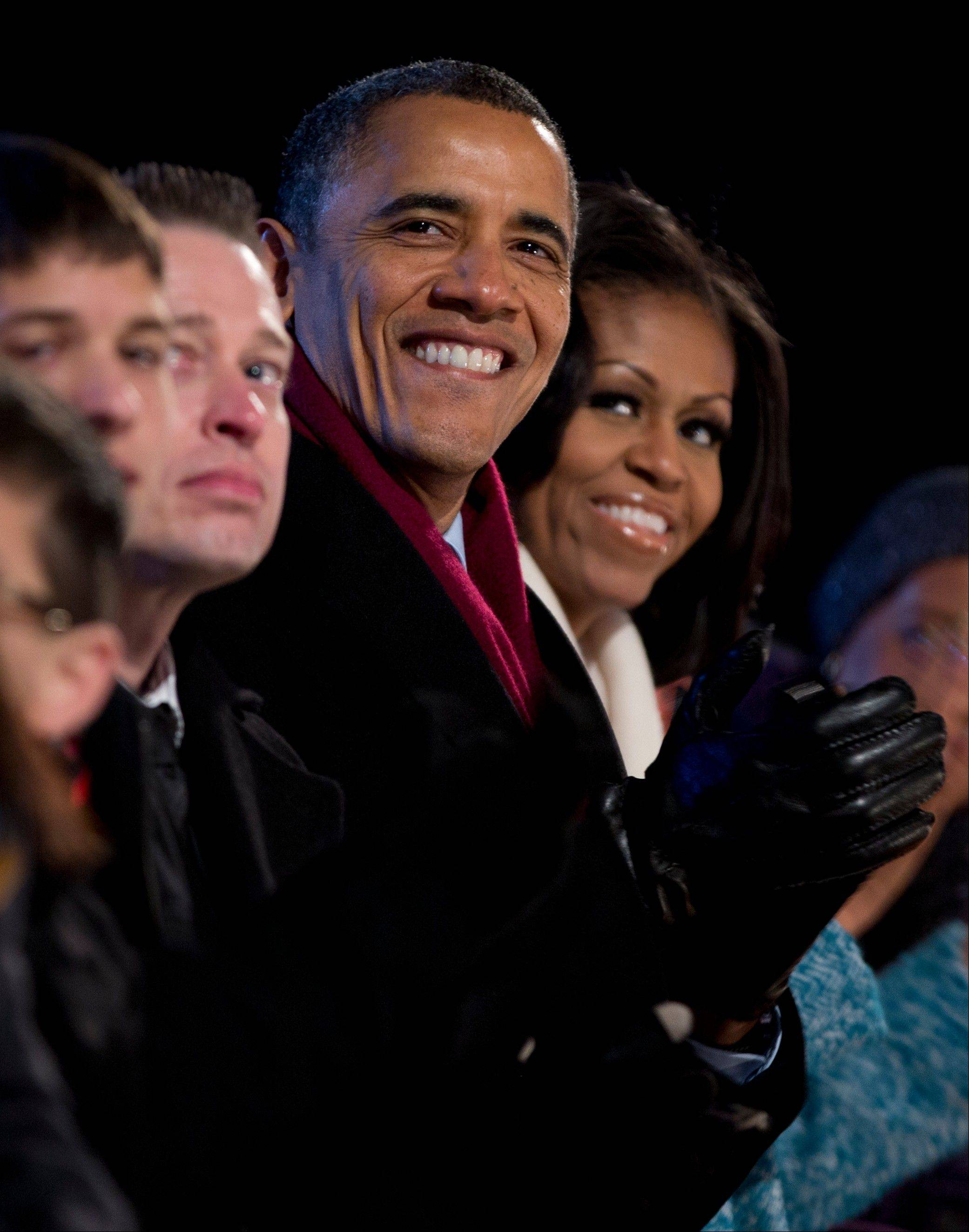 President Barack Obama and first Lady Michelle Obama look to the stage Thursday during the National Christmas Tree Lighting on the Ellipse, in Washington D.C.
