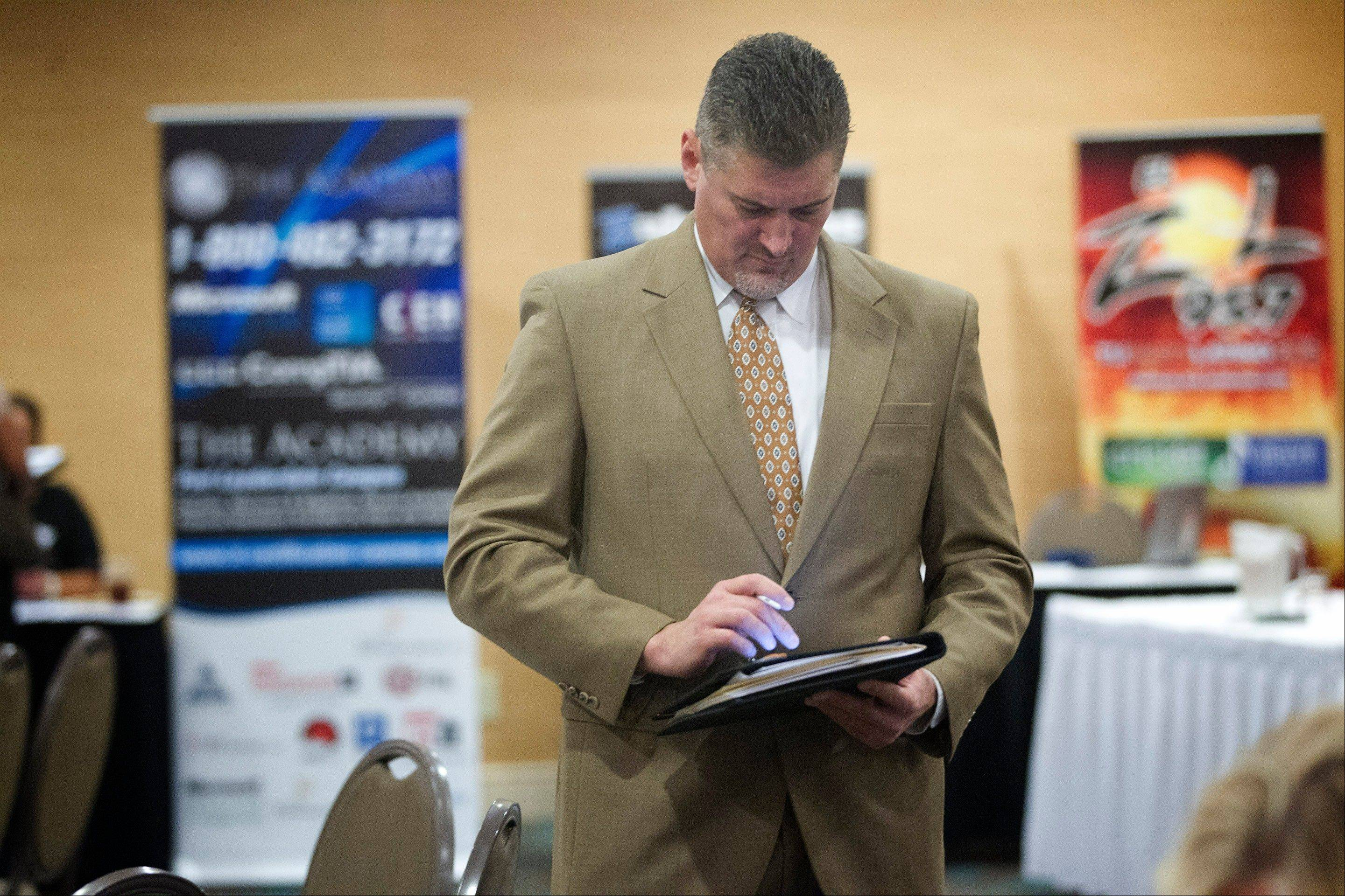 An unidentified jobseeker uses his iPad to help fill out job applications in Florida earlier this year.