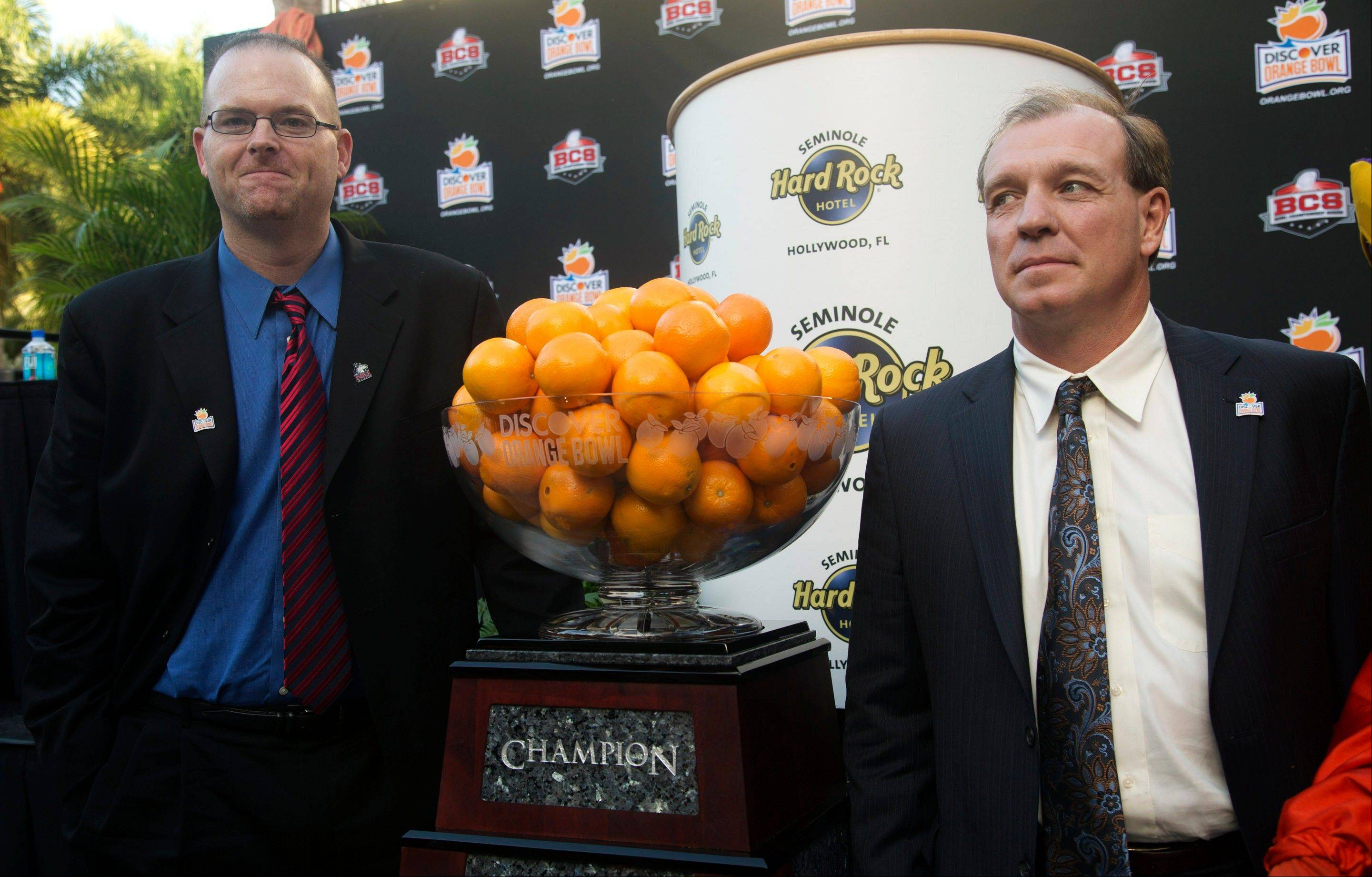 Northern Illinois head coach Rod Carey, left, and Florida State head coach Jimbo Fisher pose for photos Wednesday after a news conference promoting the Orange Bowl in Hollywood, Fla. Carey, who served as offensive coordinator the past 12 games and has been the line coach for two years, will make his head coaching debut. He replaces Dave Doeren, who took the North Carolina State job.