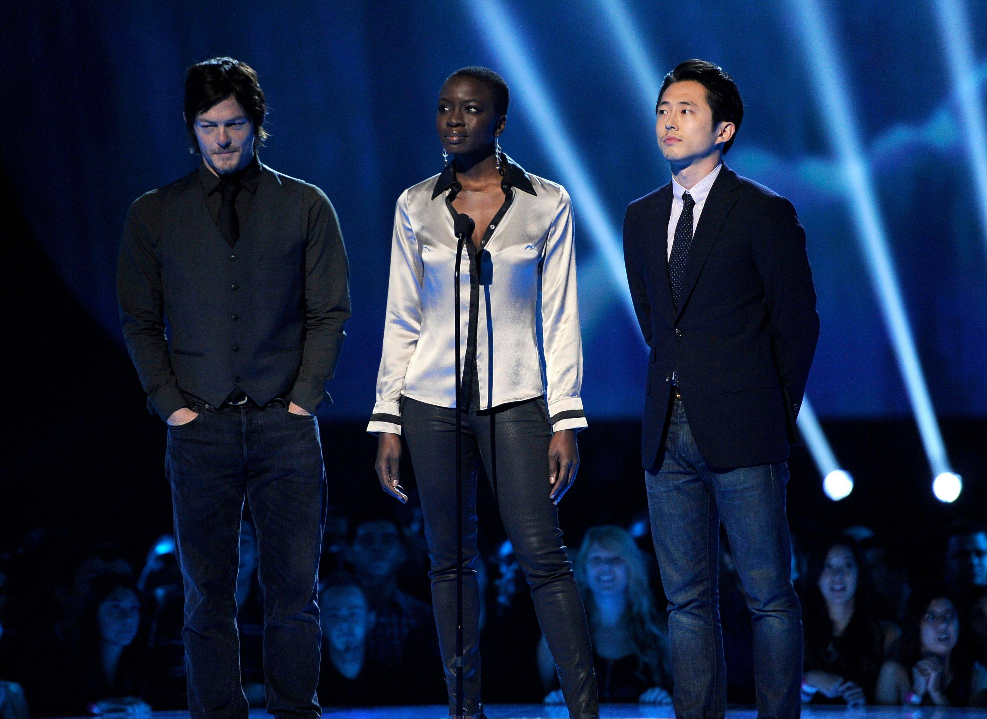 From left, Norman Reedus, Danai Gurira and Steven Yeun present the award for best shooter onstage Friday at Spike's 10th Annual Video Game Awards at Sony Studios.