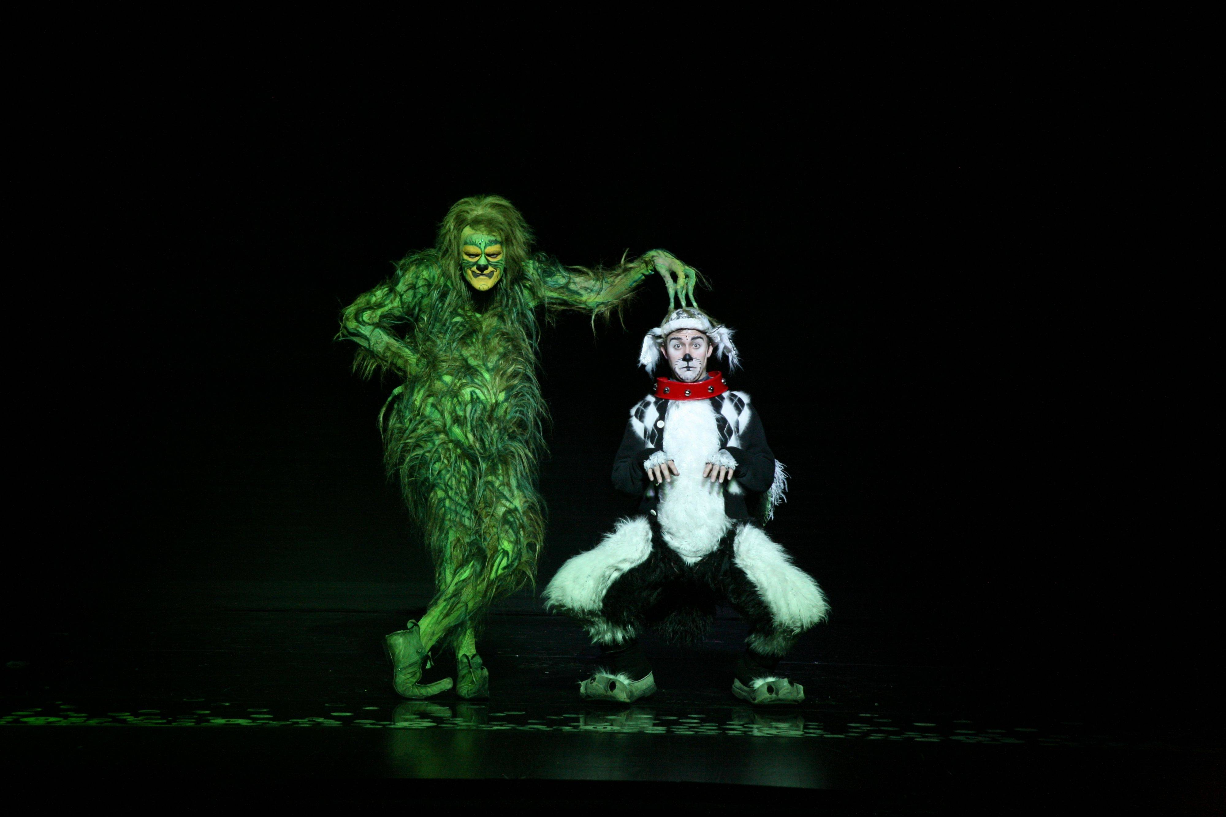 "Stefan Karl, left, delivers a tour-de-force performance as the Grinch, while Seth Bazacas is spunky as his loyal dog, Max, in Broadway in Chicago's ""Dr. Seuss' How the Grinch Stole Christmas! The Musical."""