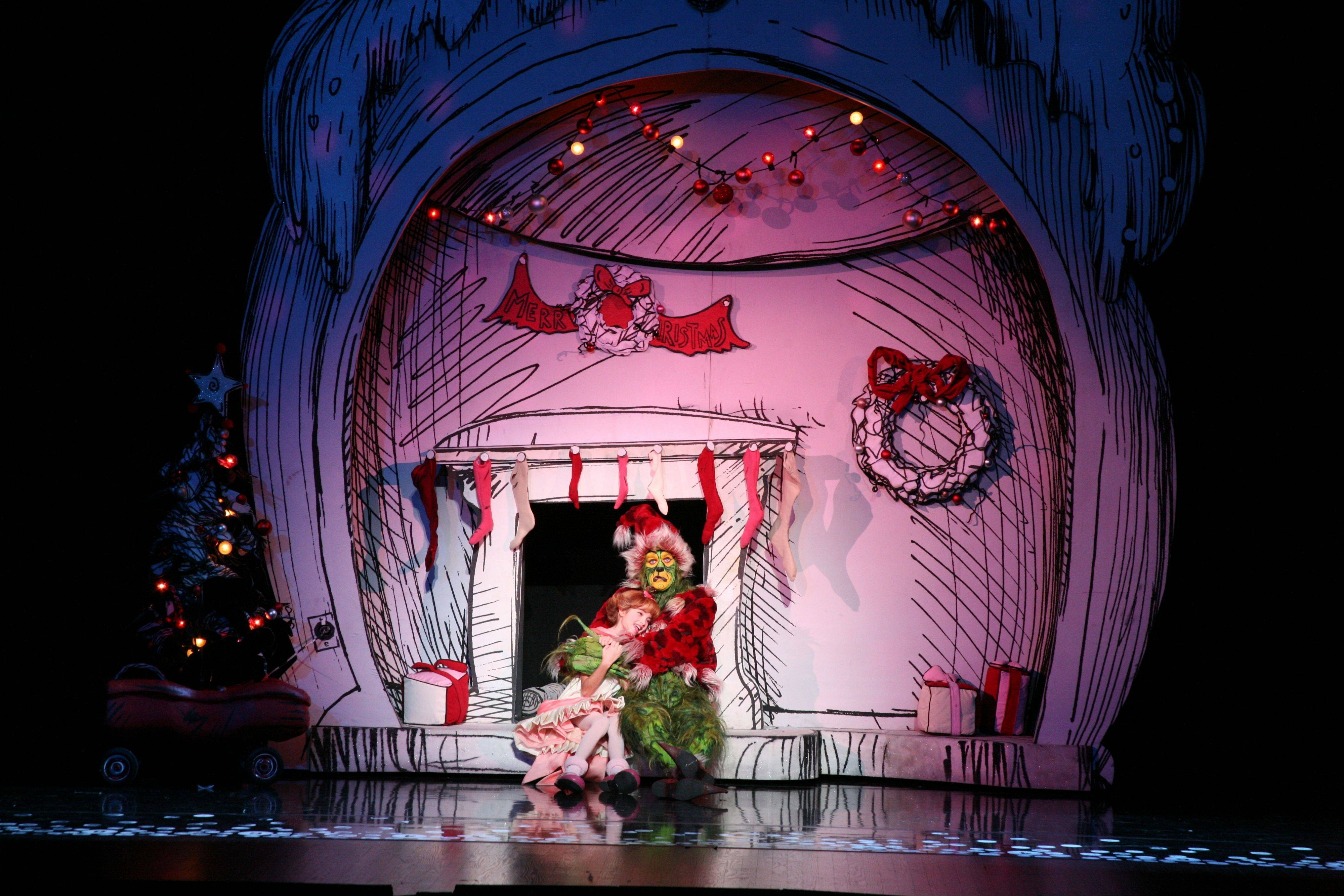 "The littlest Who melts the heart of a most grouchy Grinch in ""Dr. Seuss How the Grinch Stole Christmas! The Musical"" running through Dec. 16 at the Cadillac Palace Theatre."