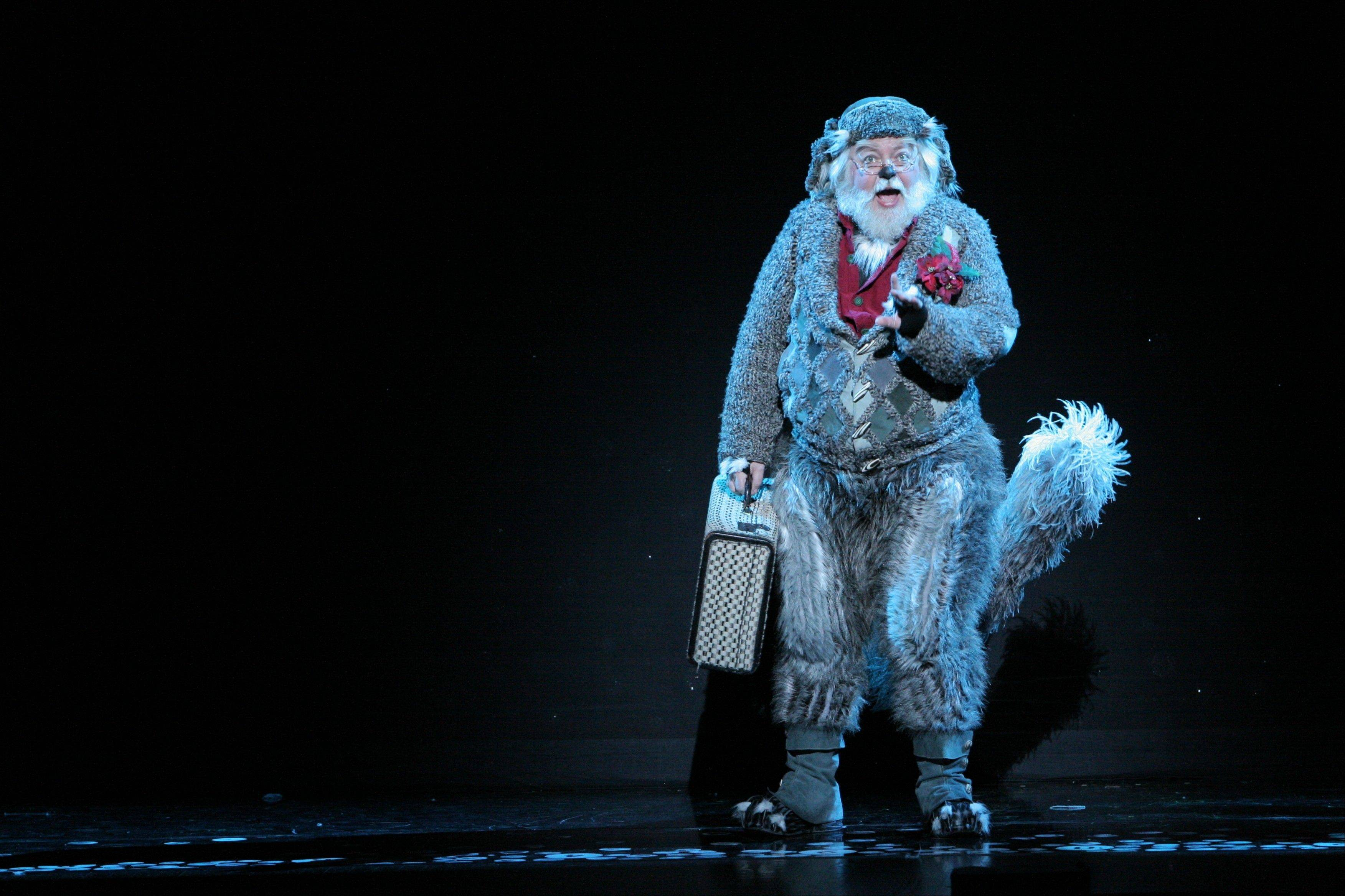 Old Max (Bob Lauder) narrates the Grinch's tale (and condemns his flaws) in the musical adaptation of Theodor Seuss Geisel's beloved book.