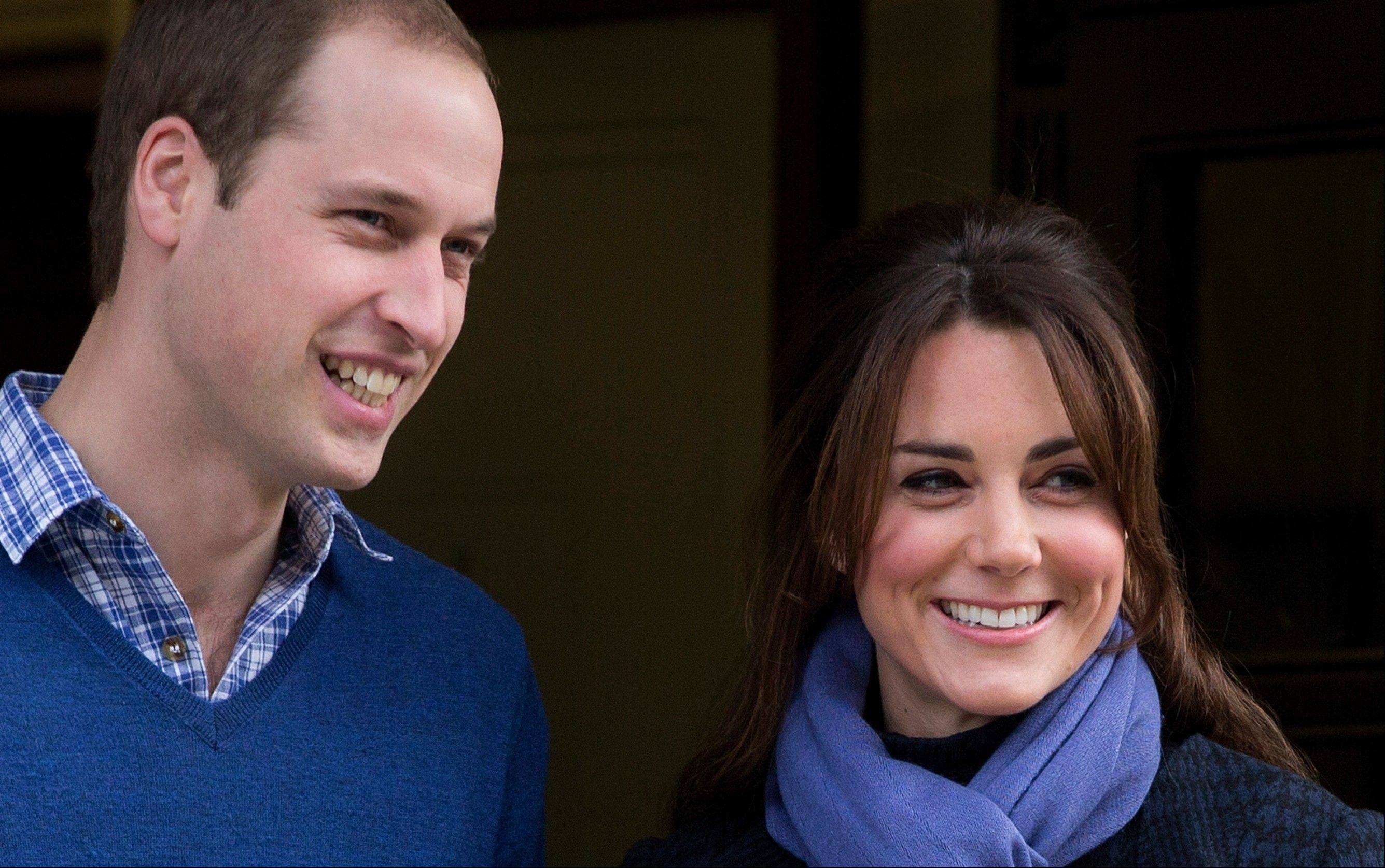 Britain's Prince William stand next to his wife Kate, Duchess of Cambridge as she leaves the King Edward VII hospital in central London, Thursday, Dec. 6, 2012. A nurse involved in a prank telephone call seeking information about the Duchess of Cambridge has died, King Edward VII hospital said Friday.