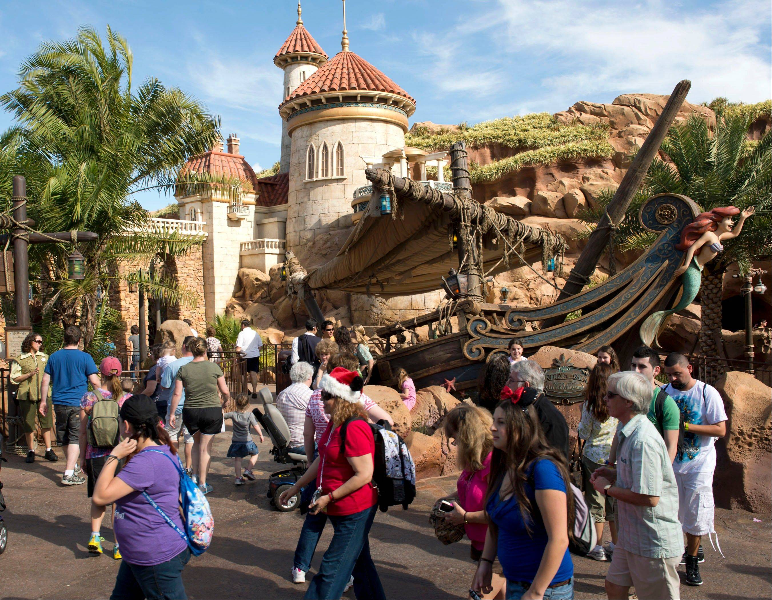 Visitors enjoy the Under the Sea: Journey of the Little Mermaid attraction following the grand opening of the New Fantasyland at Walt Disney World Resort in Lake Buena Vista, Fla. It's the largest expansion project in the park's 41-year history.