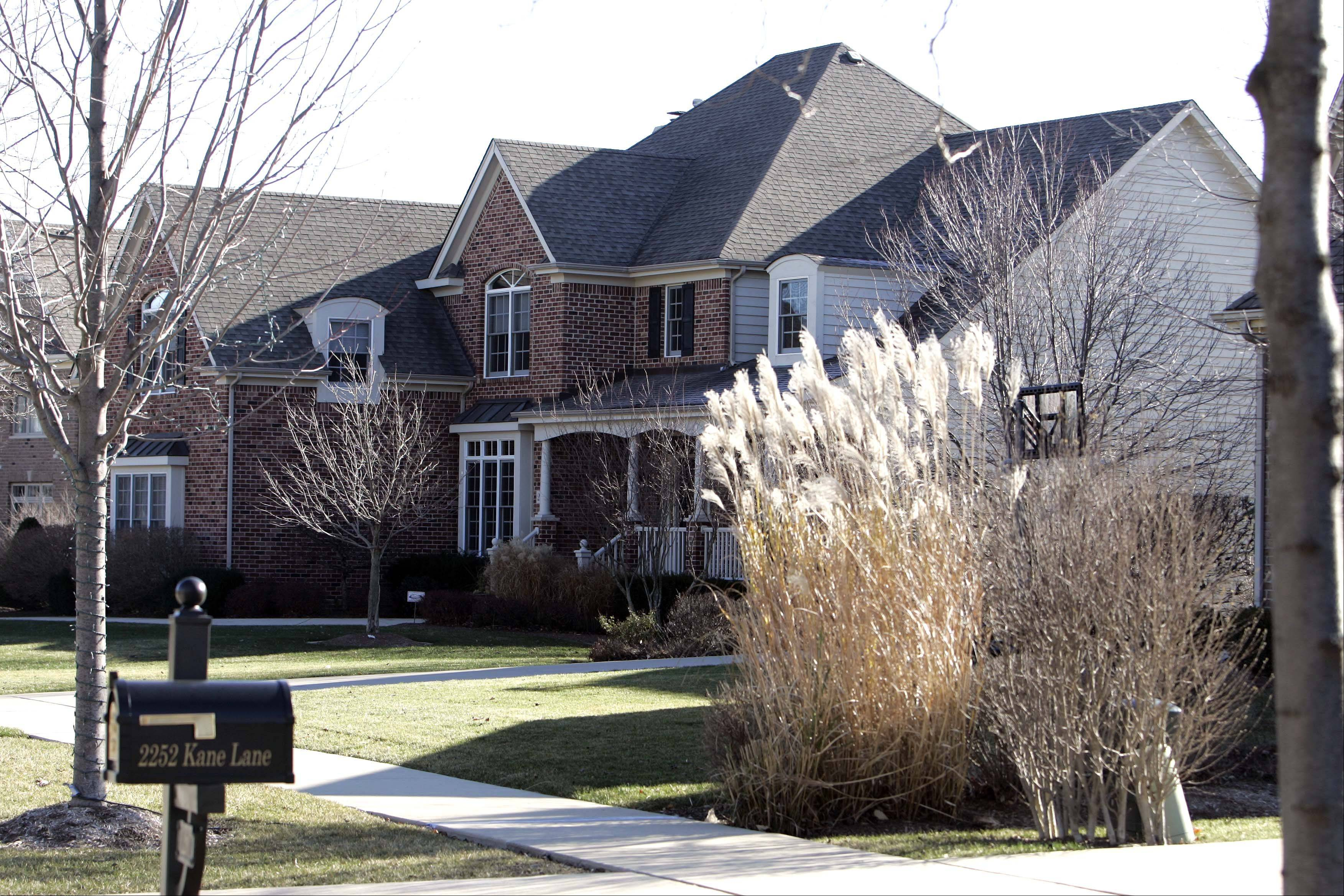The homes along Kane Lane show a range of landscaping in Tanglewood Hills in Batavia.