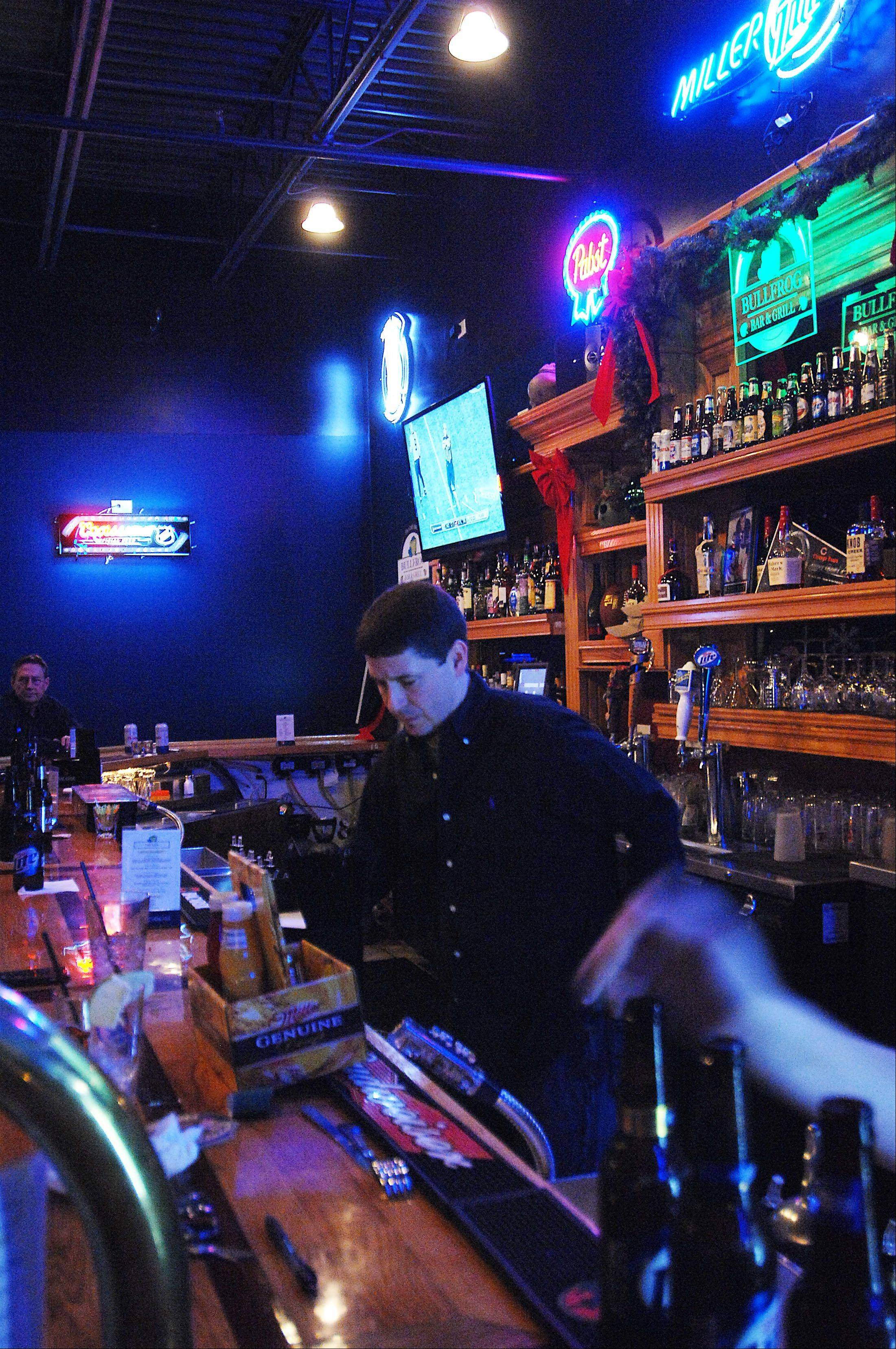 Mike Morrison pours drinks at The Chubby Bullfrog on Huntley Road in West Dundee.