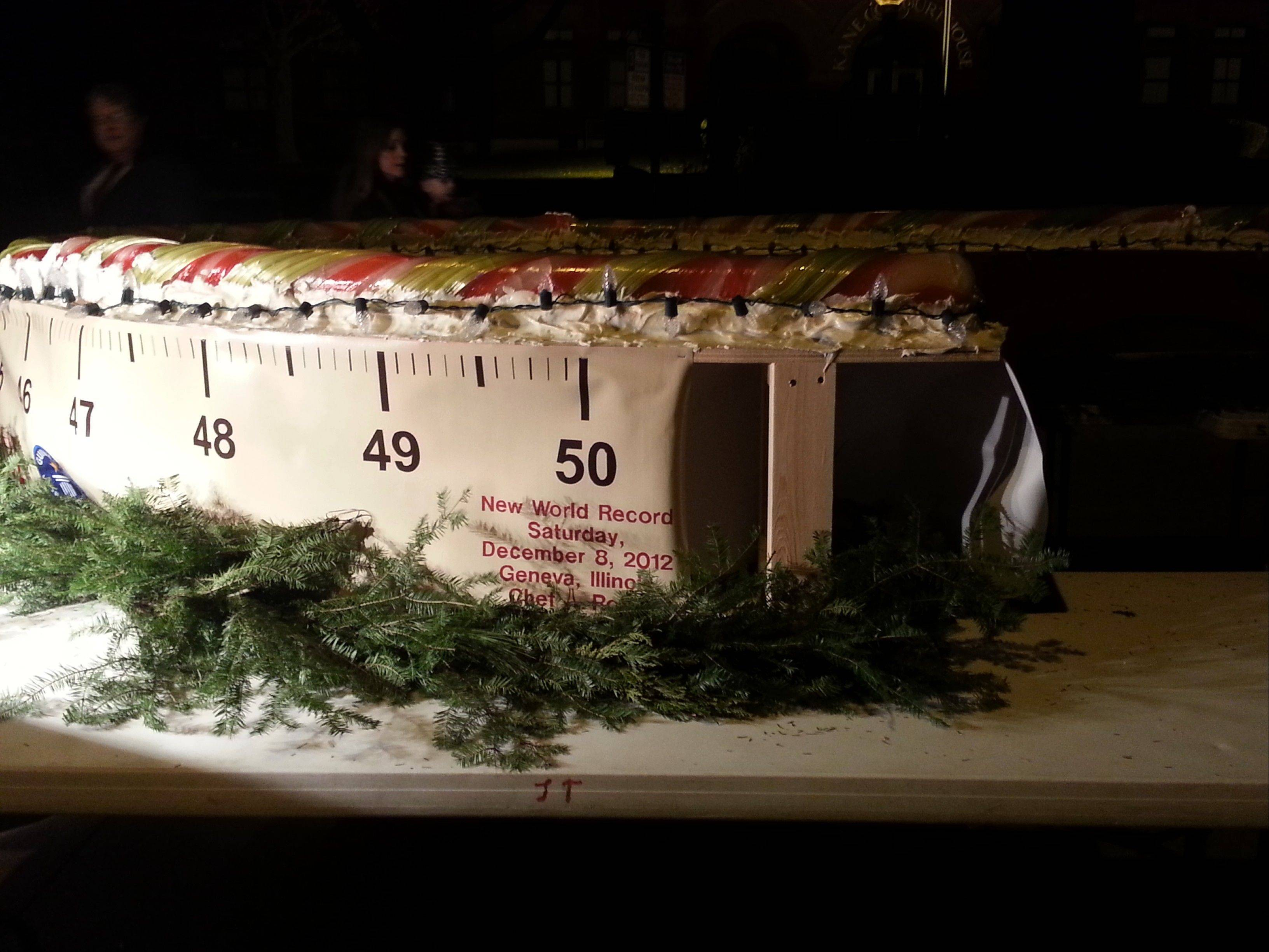Chef Alain Roby breaks the record for the world's longest candy cane -- measured at 51 feet -- Saturday night in Geneva.