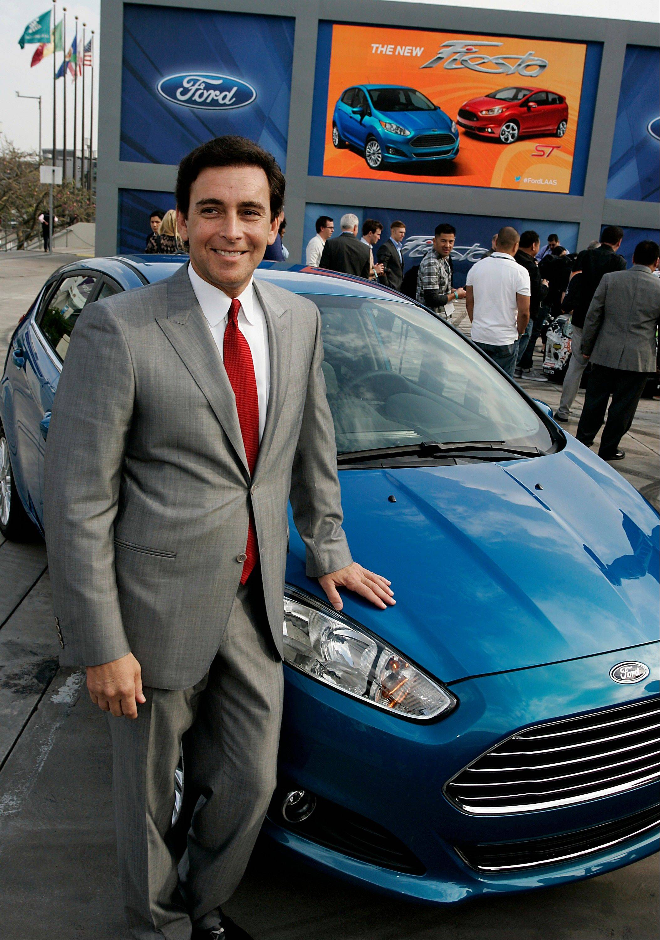 Mark Fields, incoming chief operating officer of Ford Motor Co., stands for a photograph with the Fiesta ST hatchback vehicle during the LA Auto Show in Los Angeles last Wednesday, Nov. 28.