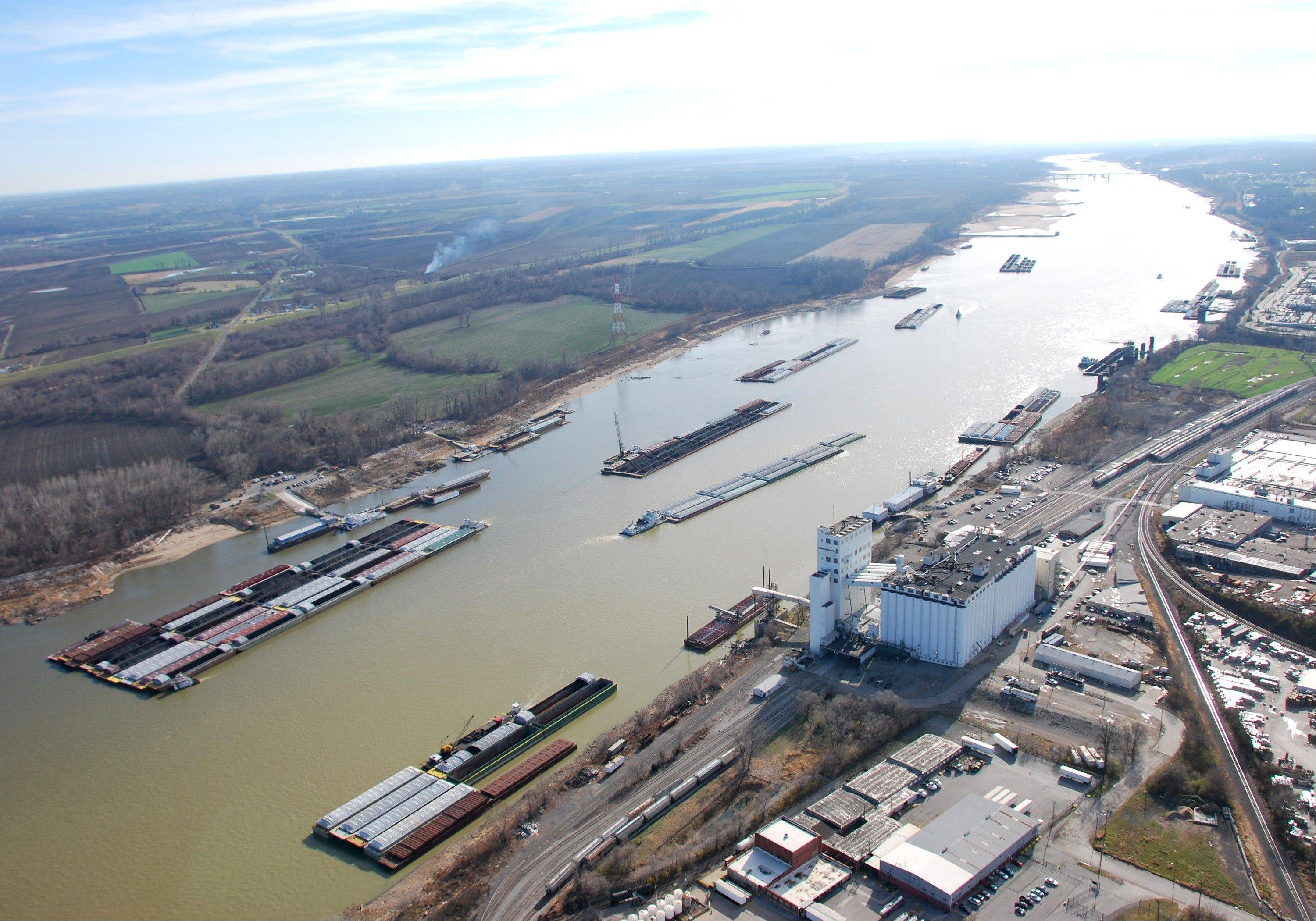 Bbarges pass in tight quarters due to low water levels as they navigate the Mississippi River Wednesday near St. Louis.
