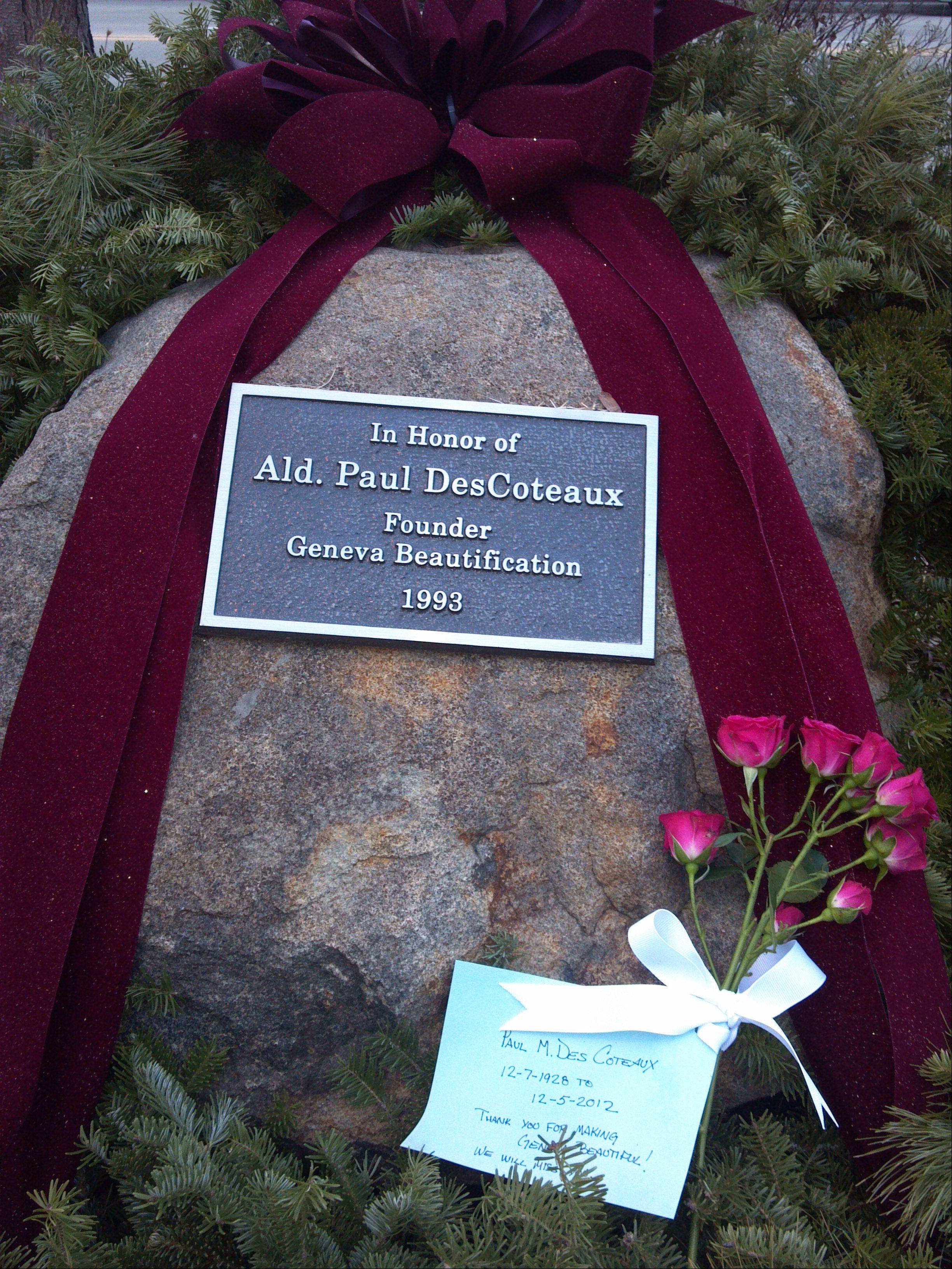 Someone placed a card and flowers on a rock outside of the Geneva downtown post office on Third Street in memory of Paul DesCoteaux, a former alderman who spearheaded downtown beautification efforts. DesCoteaux died this week at the age of 83.
